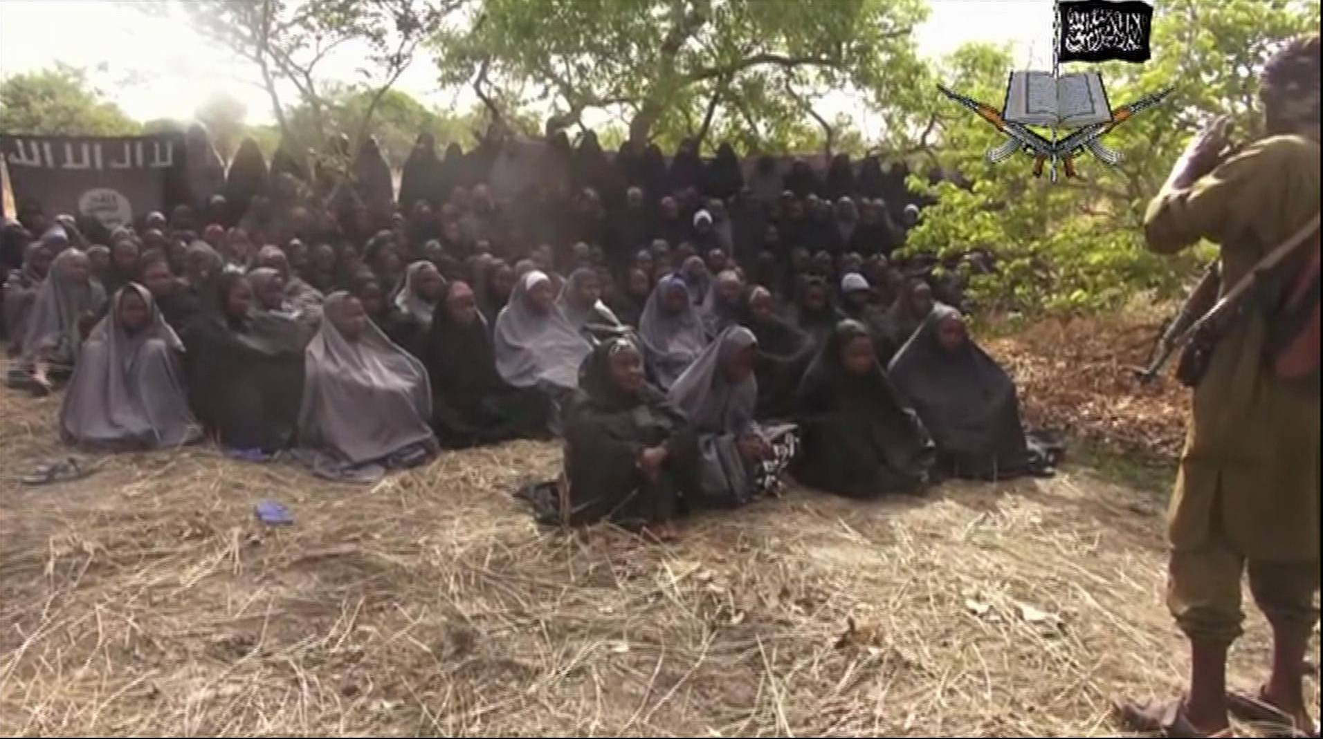 This photo, taken from a video by Nigeria's Boko Haram terrorist network, purports to show dozens of abducted schoolgirls, covered in jihab and praying in Arabic. It is the first public sight of the girls since more than 300 were kidnapped from a northeastern school the night of April 14 four weeks ago.