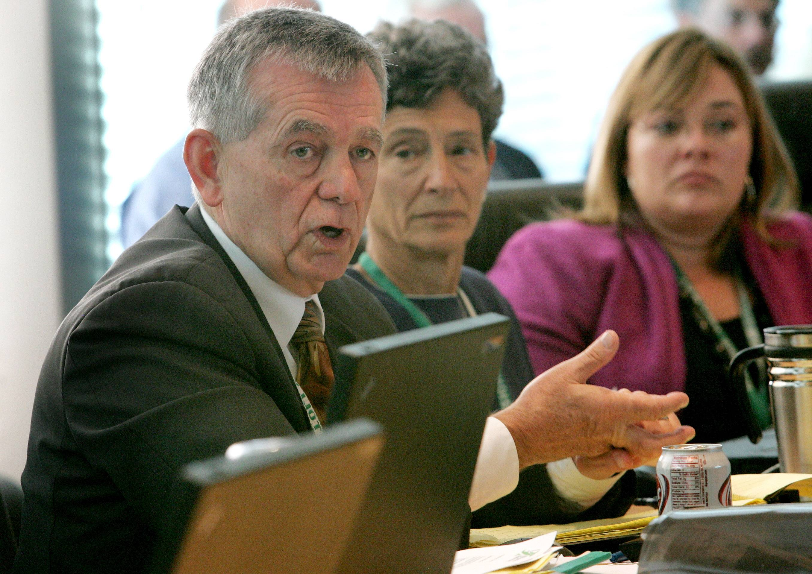 Former tollway Director Bill Morris explains why he opposes a toll increase as board Chair Paula Wolff, center, and Executive Director Kristi Lafleur listen in 2011.