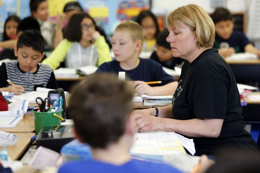 Substitute teacher Sue Burke leads fifth-grade students through math problems at Hillcrest Elementary School in Elgin. The school district's Citizens' Advisory Committee presented a report last week on future enrollment, and Hillcrest was deemed over capacity.