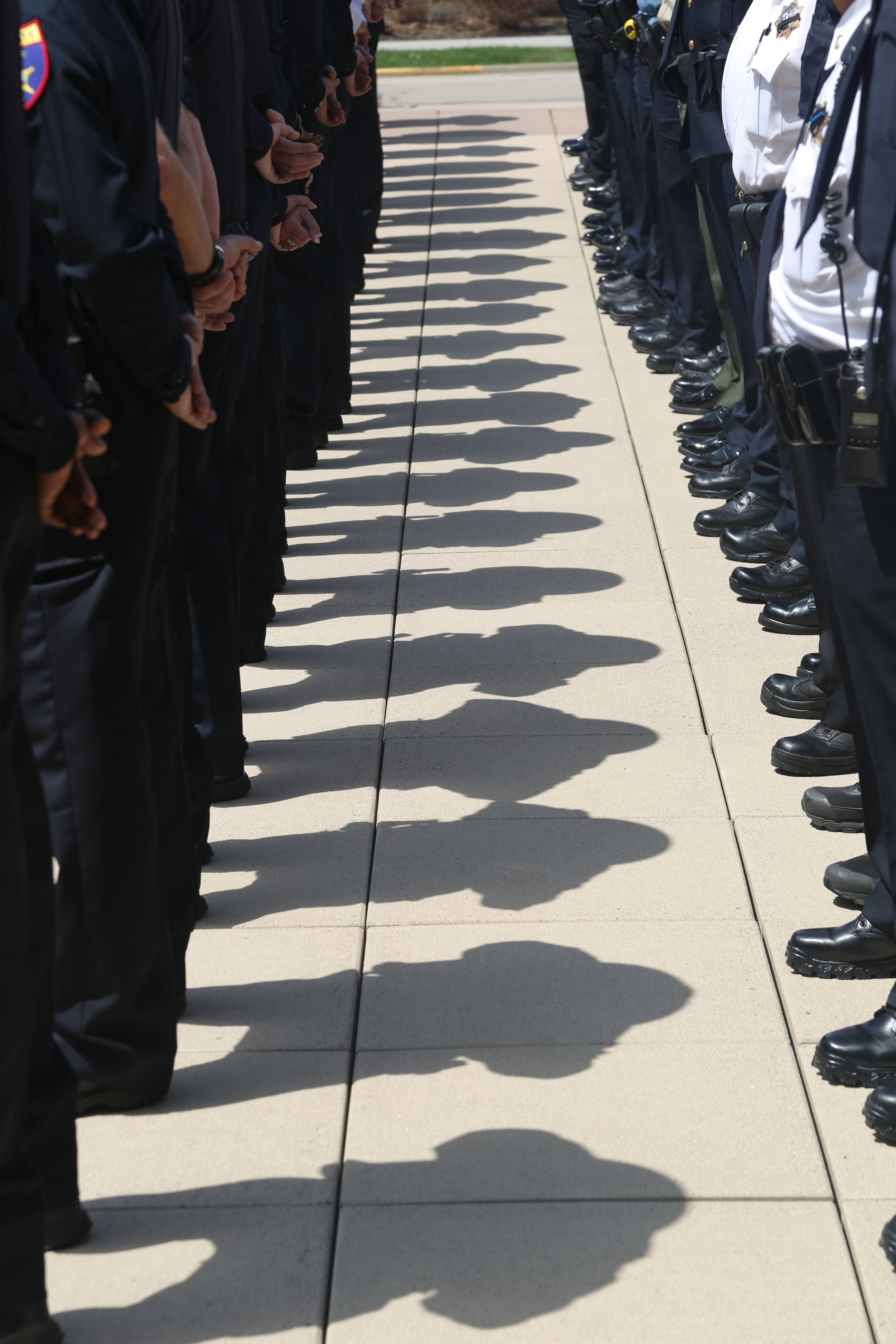 Local police officers stand at attention during the Lake County Police Memorial Friday at Lincoln Memorial Plaza in Waukegan. The ceremony honored 17 officers that have fallen in the past years.