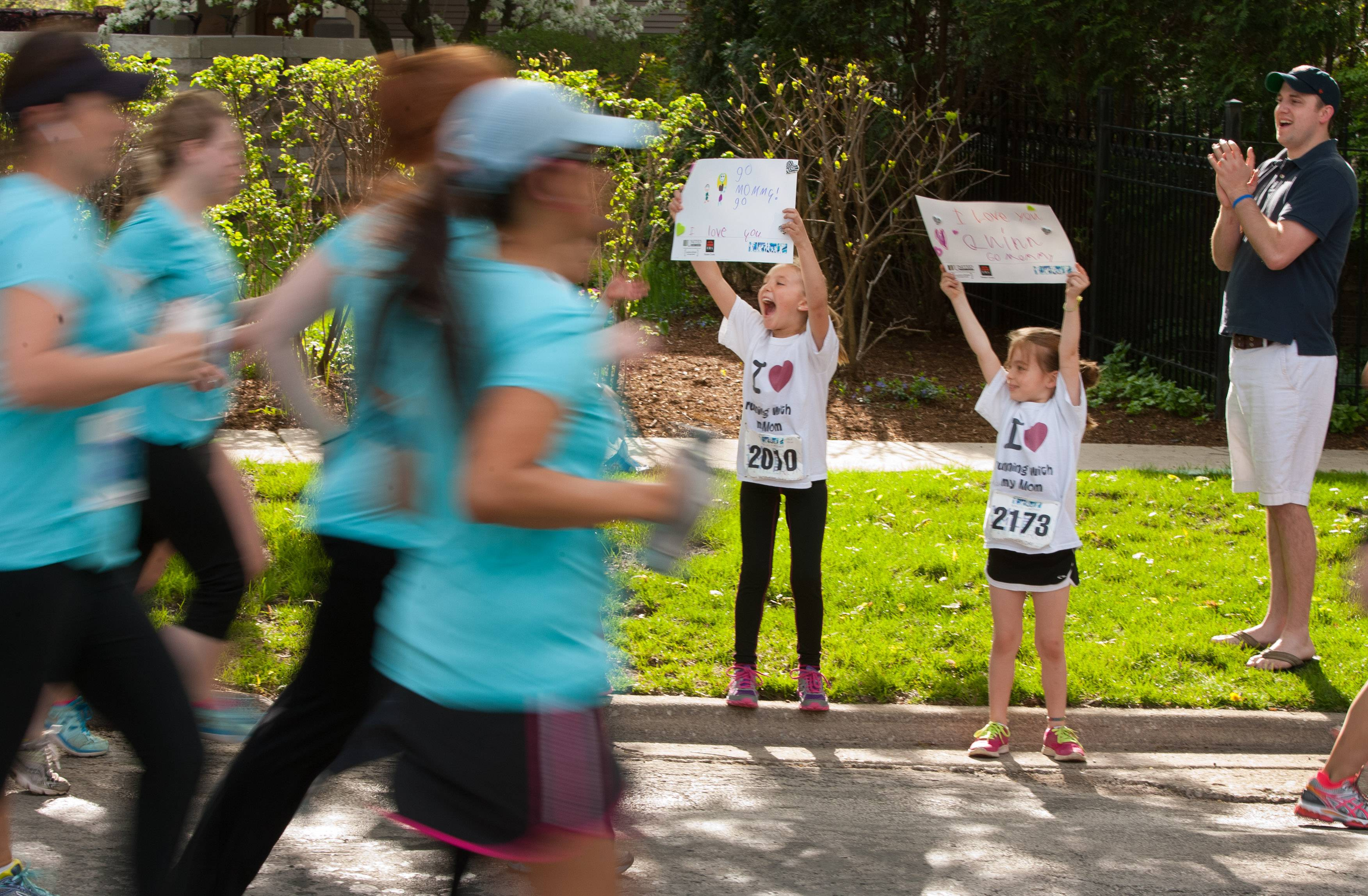 Kylie Frigo, 7, of Naperville, and Quinn Shulski, 6, of Lake in the Hills, cheer and look for their mothers who are participating in the Run Like a Mother 5K Hinsdale race. The run raises money to enrich the lives of children with Angelman syndrome.
