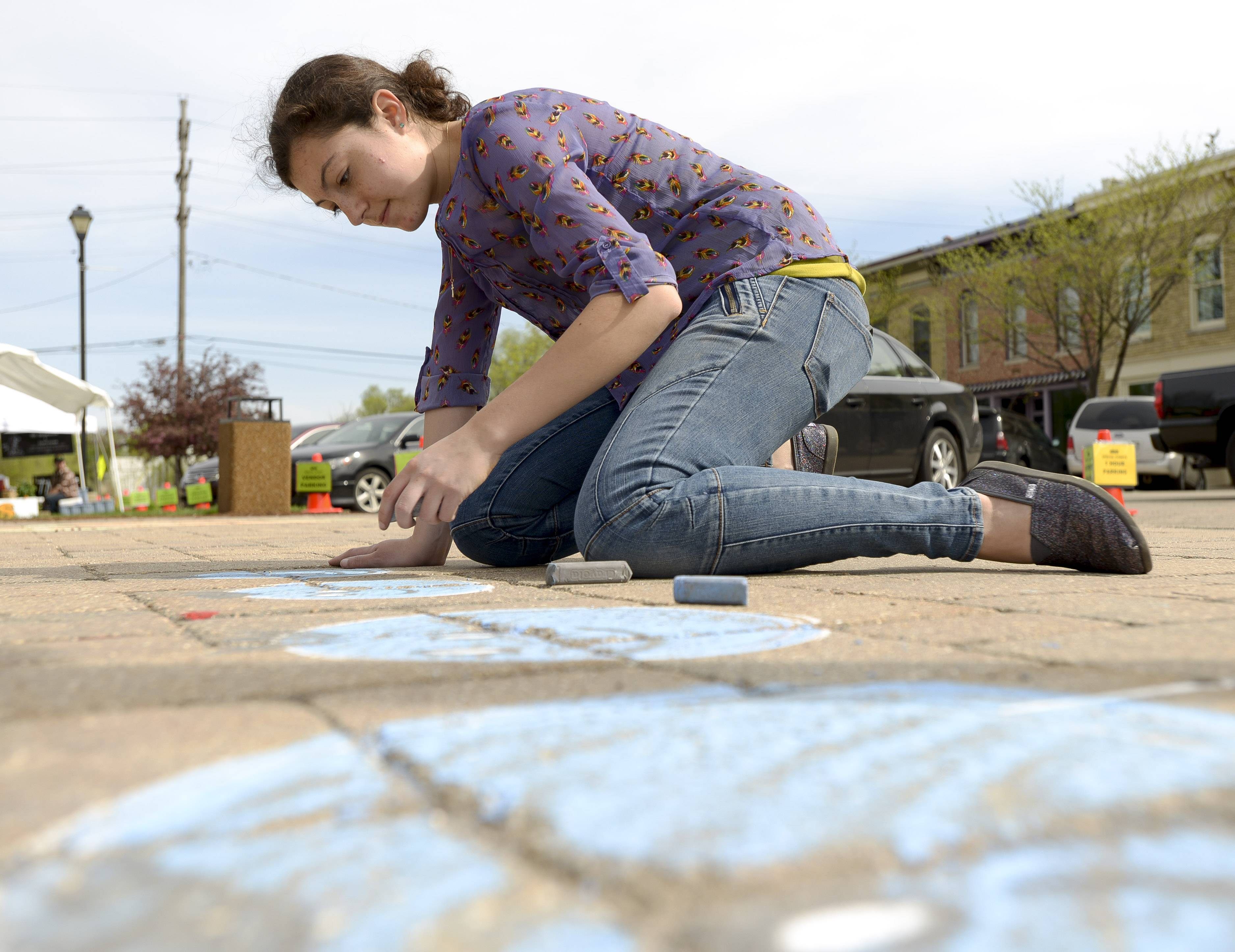 Artist Lindsay Lleras, of Algonquin, created some sidewalk chalk art for the enjoyment for those attending the Mother's Day Depot Farmers Market in East Dundee.