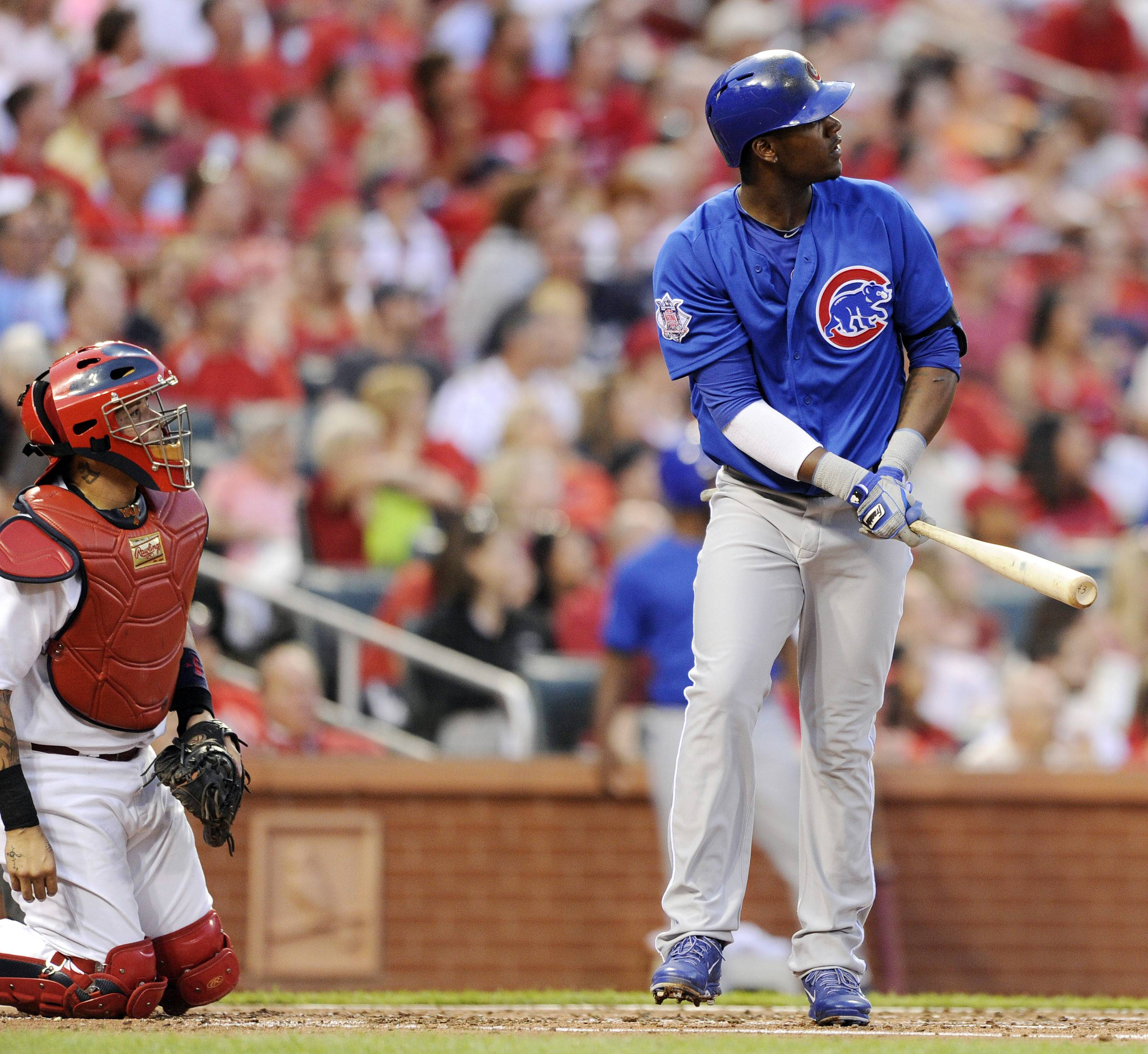 The Cubs' Junior Lake watches his 3-run homer as Cardinals catcher Yadier Molina looks on in the second inning Monday night. Lake finished with 6 RBI.