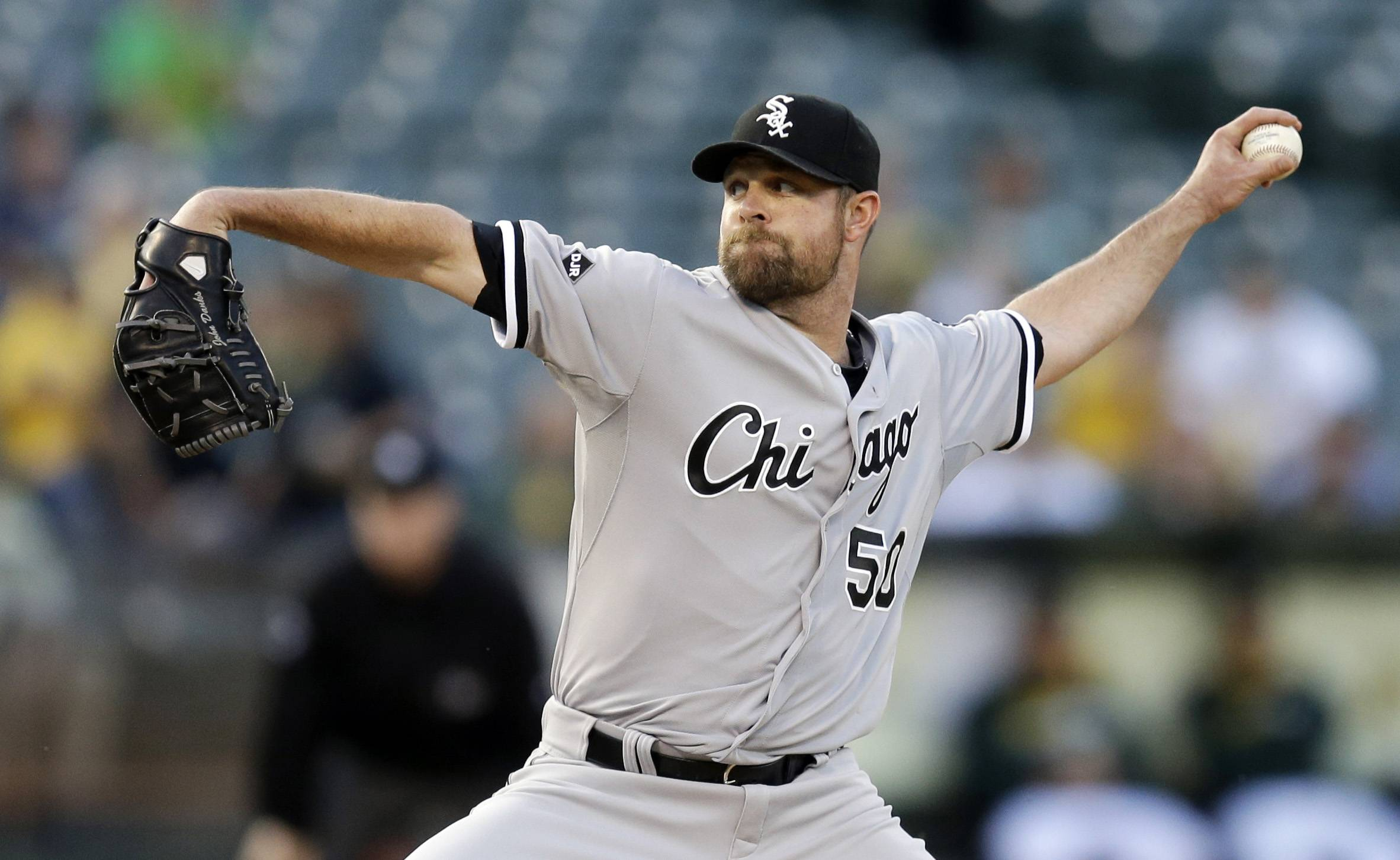 White Sox starter John Danks works against the Athletics in the first inning Monday night in Oakland.