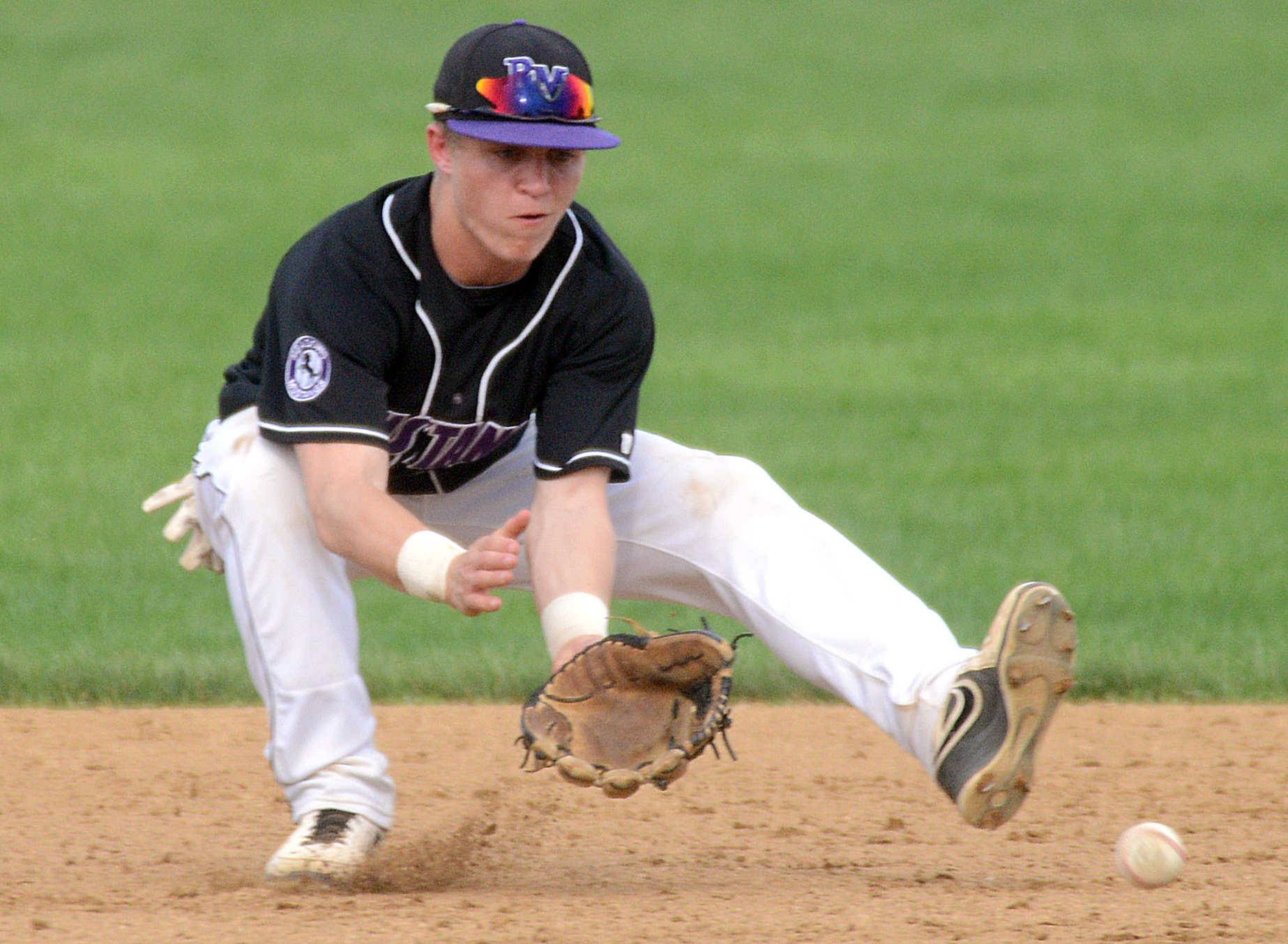 Rolling Meadows' Alex Niecikowski fields a grounder against Elk Grove on Monday.