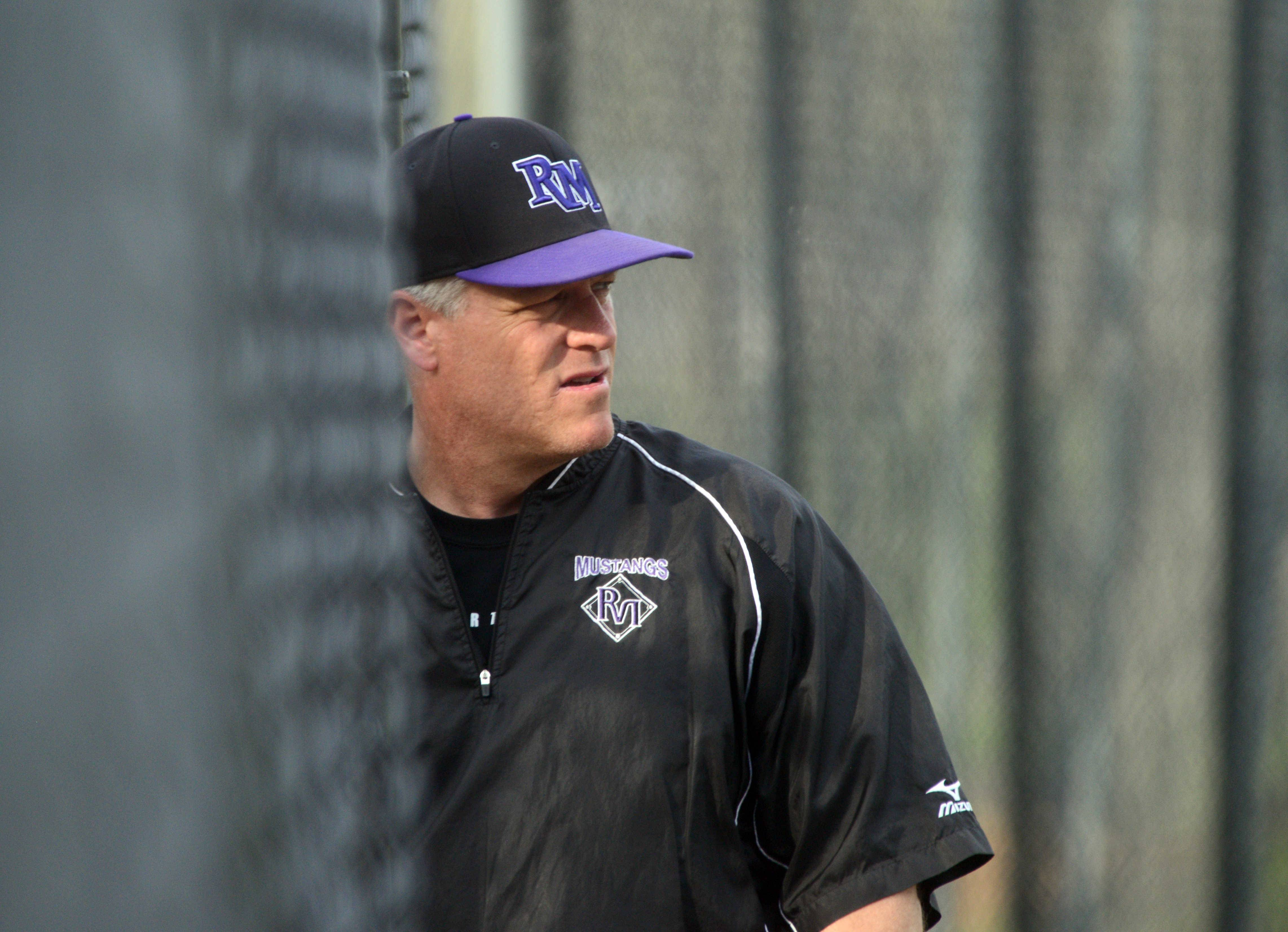 Rolling Meadows skipper Jim Lindeman watches the Mustangs take the field against Elk Grove on Monday.