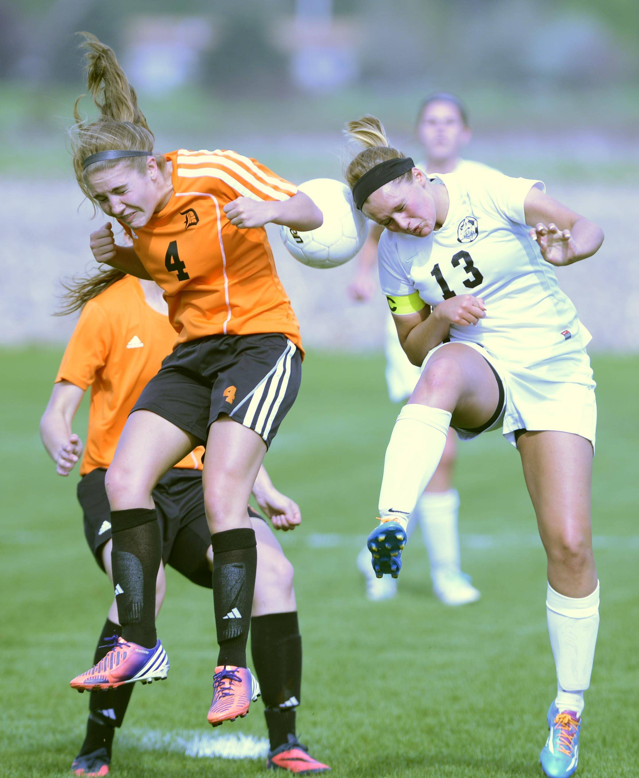 Kaneland's Delaney Stryczek, right, heads the ball Monday in Maple Park.