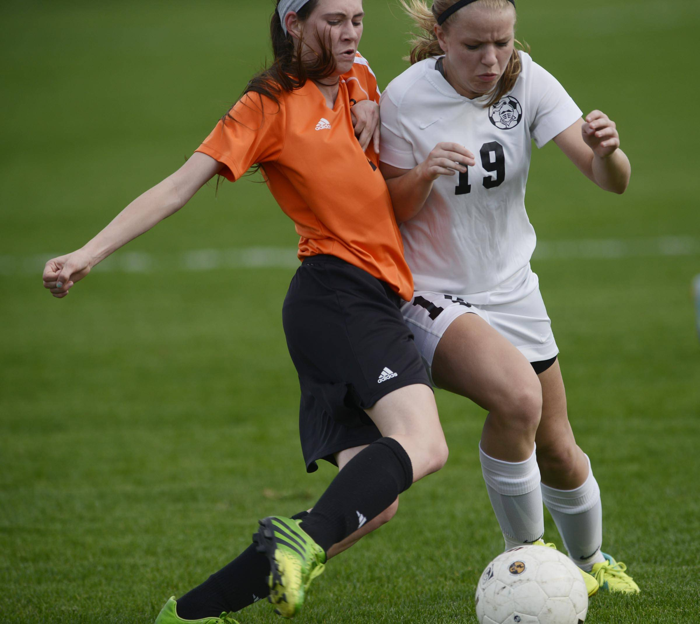 Kaneland's Nicole Koczka, right, competes for the ball Monday in Maple Park.