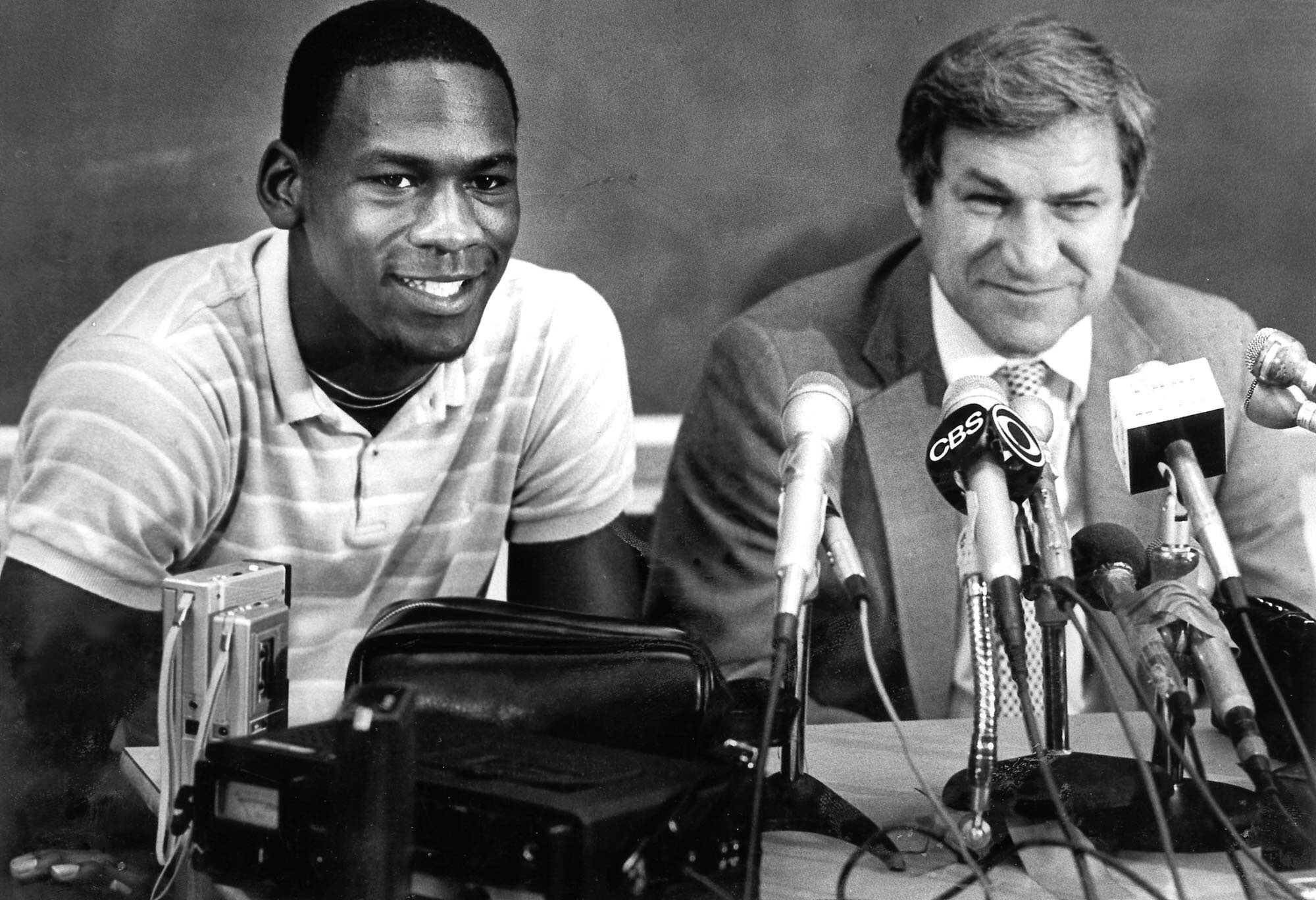 According to a new book, Michael Jordan was considering going to Virginia instead of playing for North Carolina head coach Dean Smith, right.  Jordan won a national title with Smith but gave up his final year of college eligibility to turn pro.