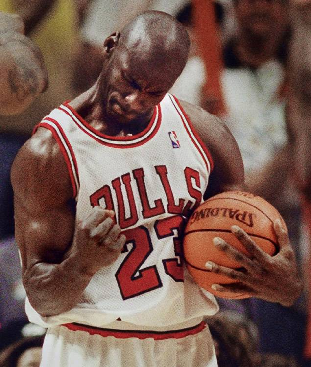 Michael Jordan celebrates a Bulls win during 1998 NBA finals at the United Center in Chicago.