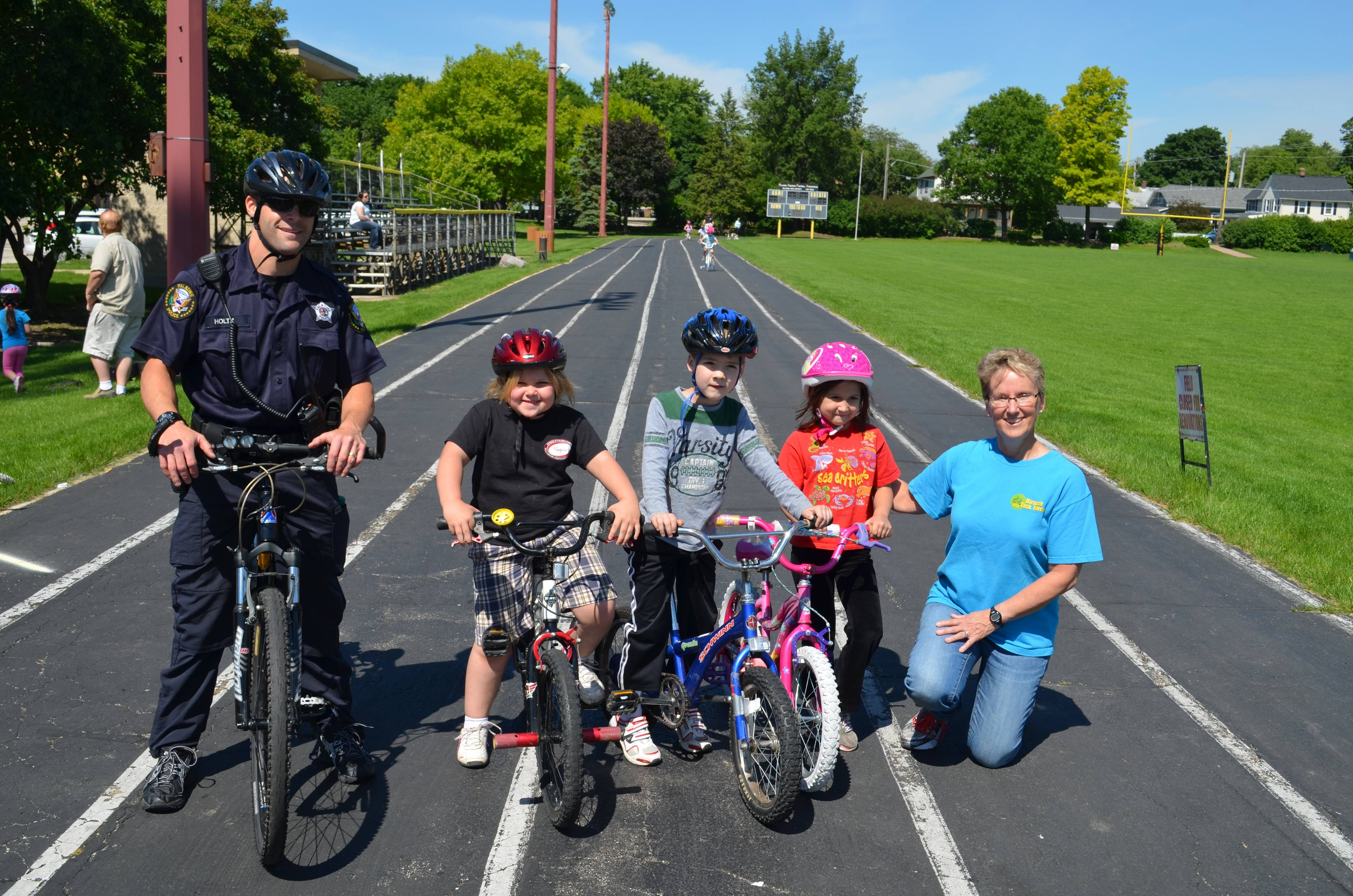 Members of the Bike Palatine Club and the Palatine Police Department work with small groups of riders at the 2013 Bike Safety Clinic and Ride.