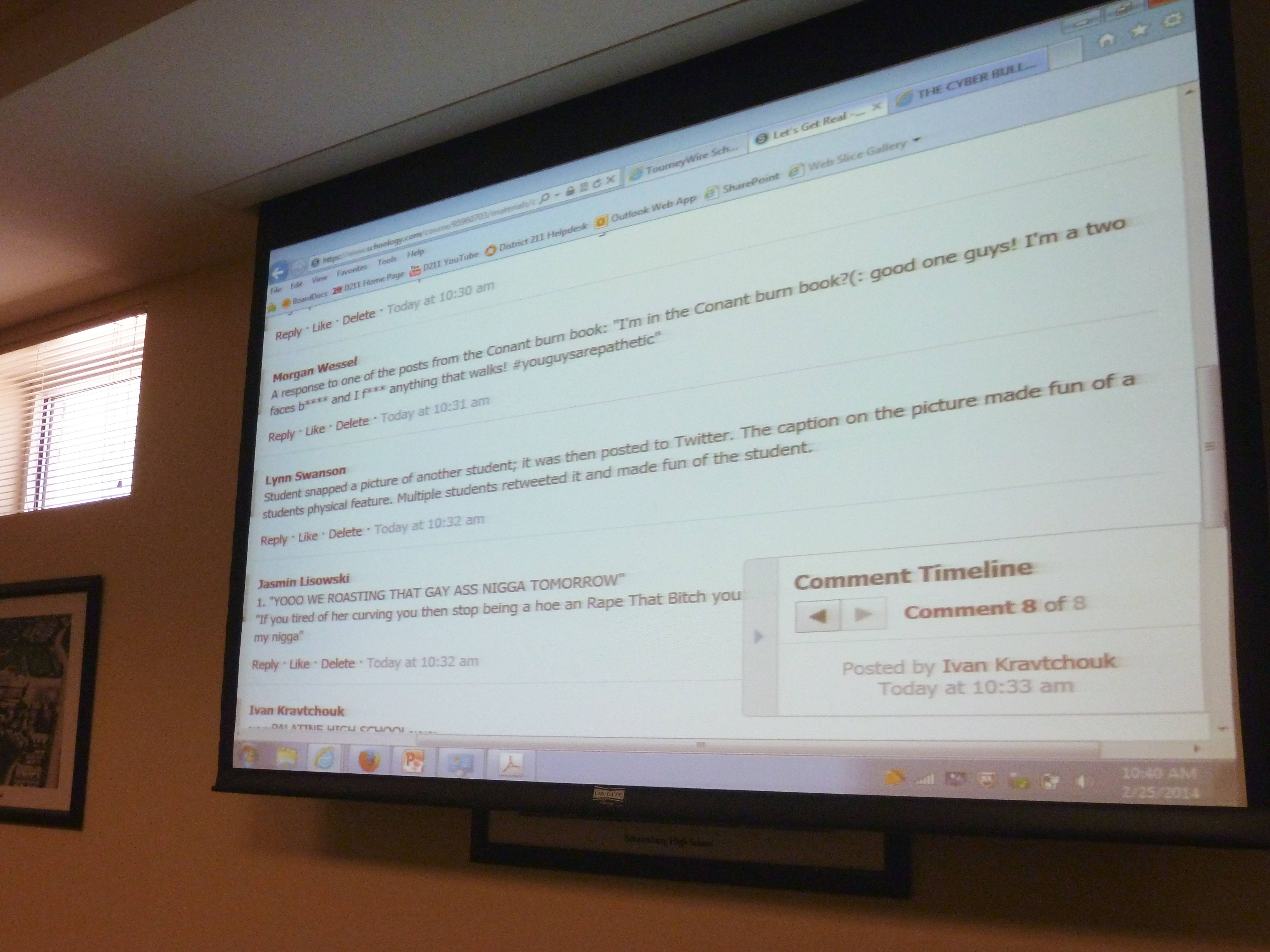 A projector displays an example of cyberbullying or negative comments posted online.