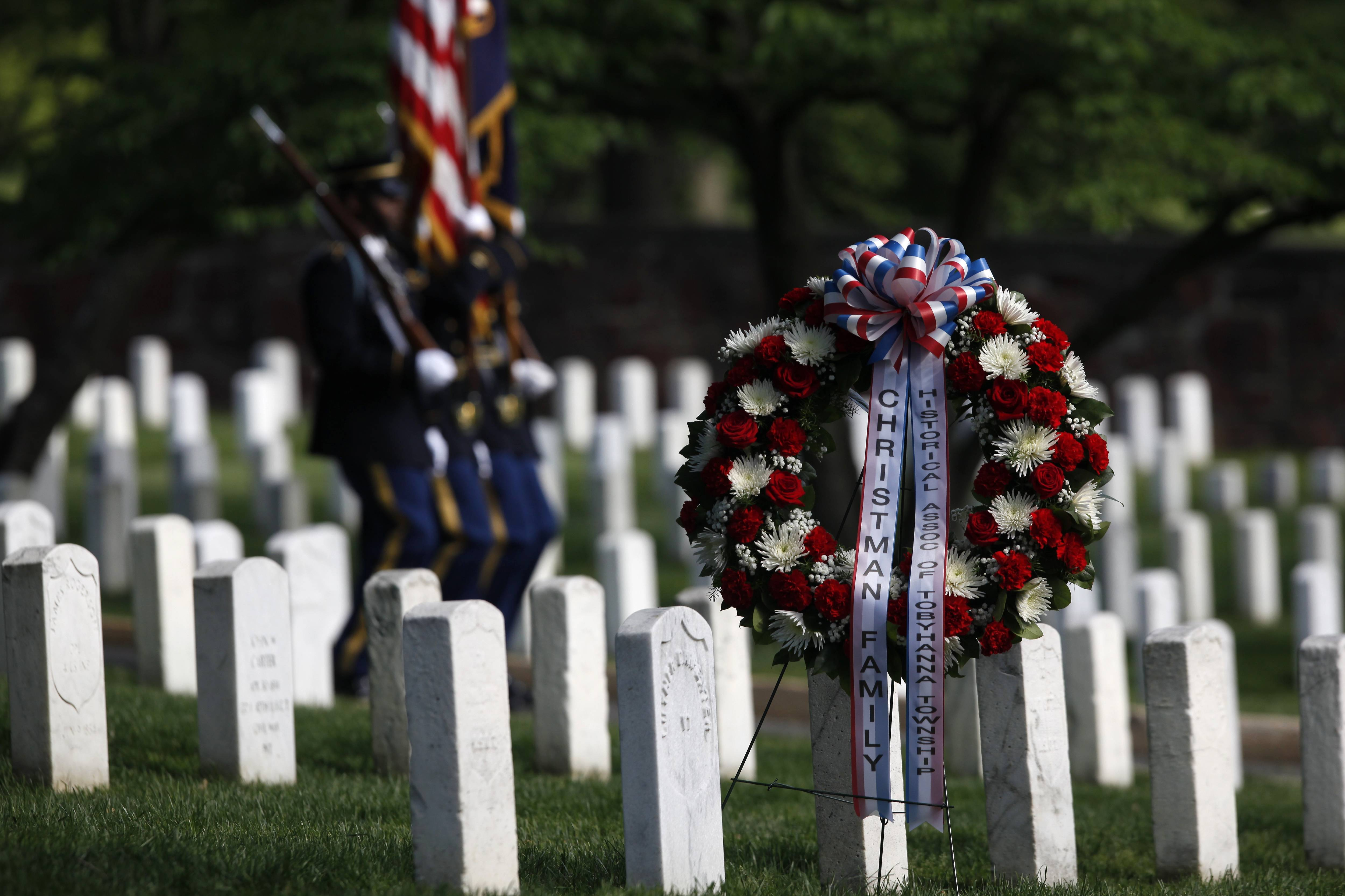 U.S. Army honor guard arrive before the wreath laying at the gravesite of Army Pvt. William Christman, who was the first military burial at the cemetery, marking the beginning of commemorations of the 150th anniversary of Arlington National Cemetery in Arlington, Va., Tuesday.