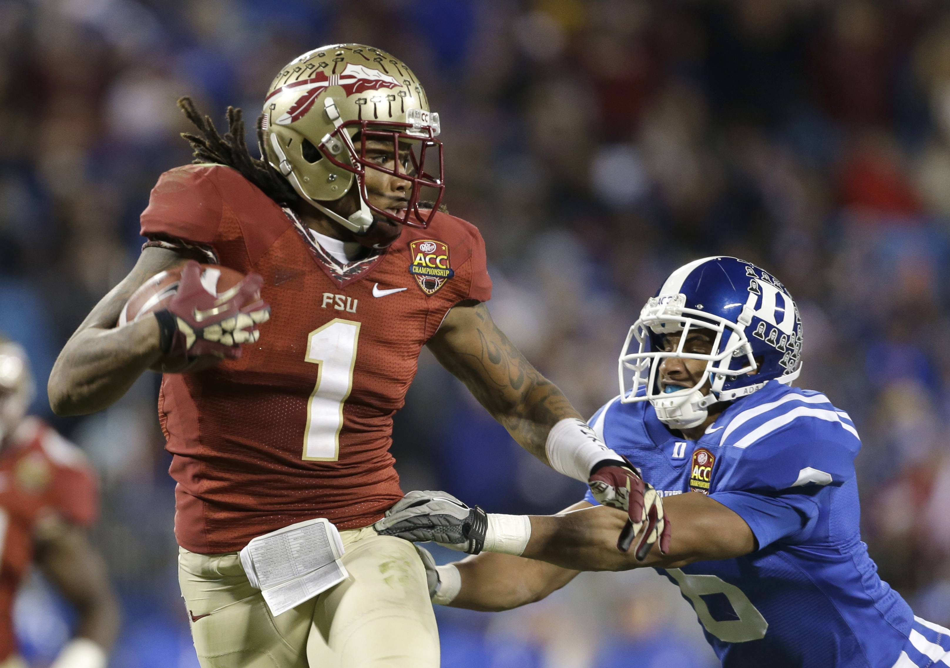 Florida State's Kelvin Benjamin (1) runs past Duke's Ross Cockrell (6) for a touchdown in the second half of the Atlantic Coast Conference Championship NCAA football game in Charlotte, N.C., Dec. 7, 2013.