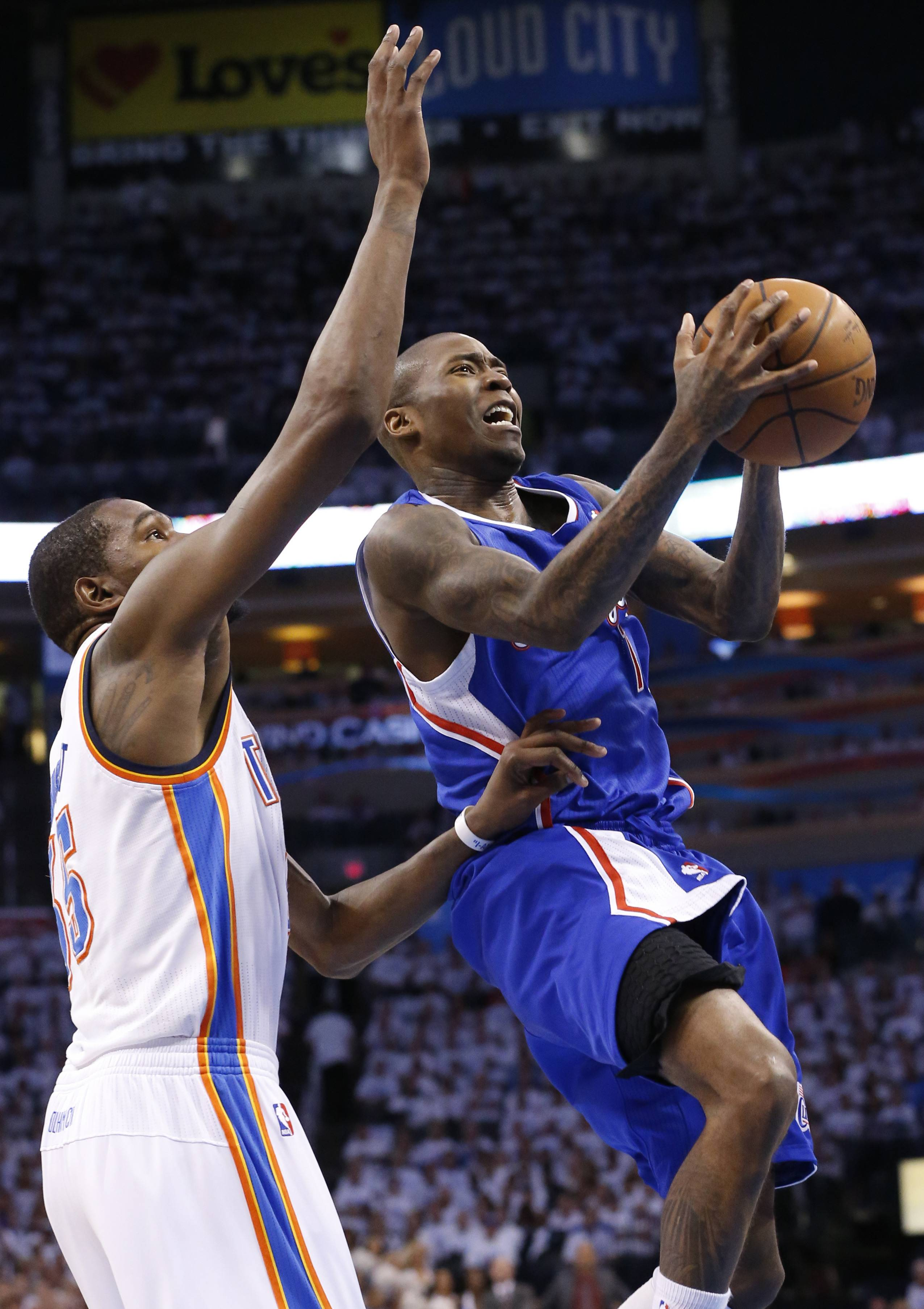 Los Angeles Clippers guard Jamal Crawford (11) shoots in front of Oklahoma City Thunder forward Kevin Durant (35) in the second quarter of Game 5 of the Western Conference semifinal NBA basketball playoff series in Oklahoma City, Tuesday, May 13, 2014. Oklahoma City won 105-104. (AP Photo)