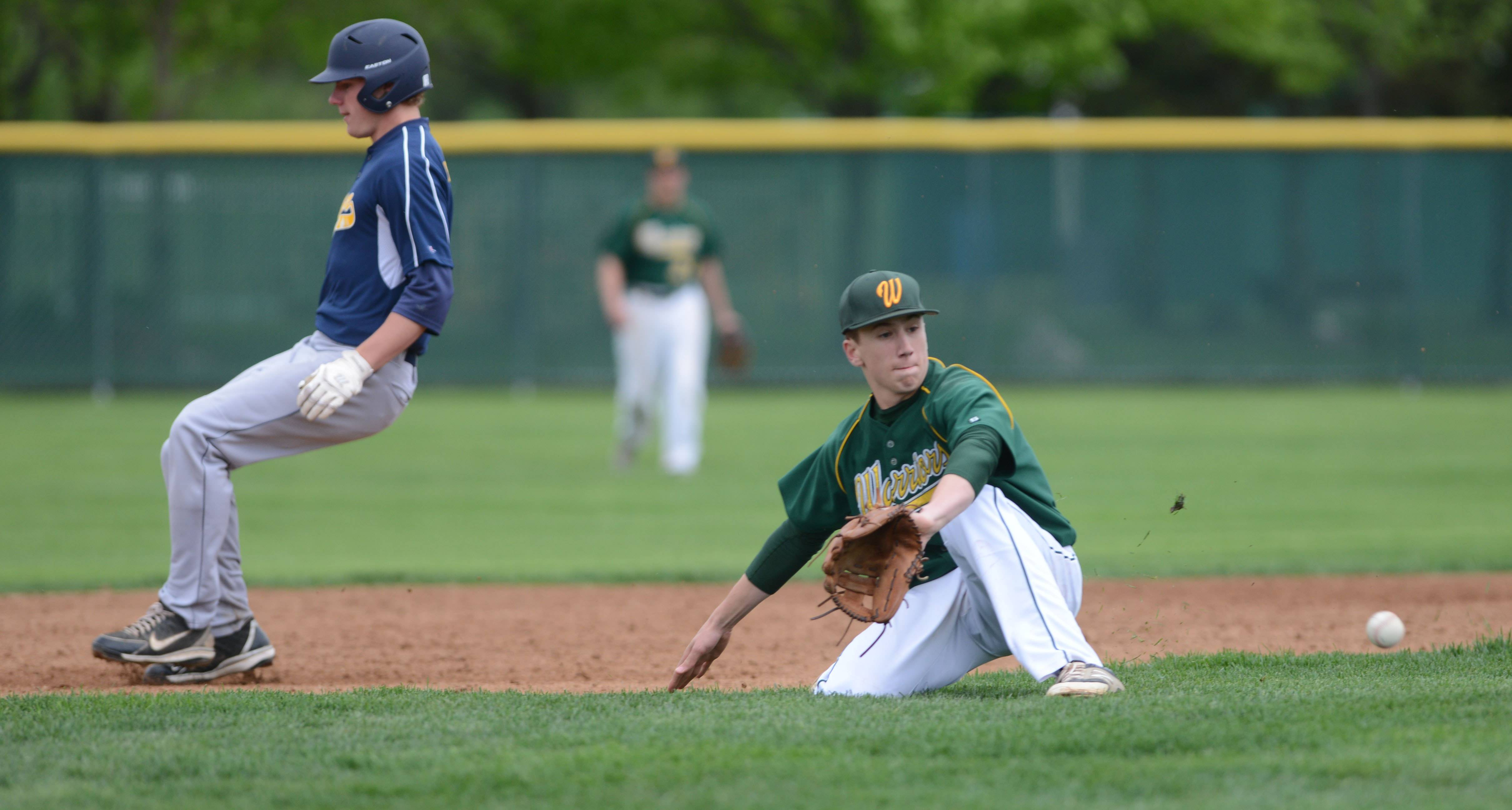 #23 Tyler Tesmond of Neuqua Valley is safe at second while Garrett Howicz of Waubonsie fields the ball during the Neuqua Valley at Waubonsie Valley baseball game Tuesday.