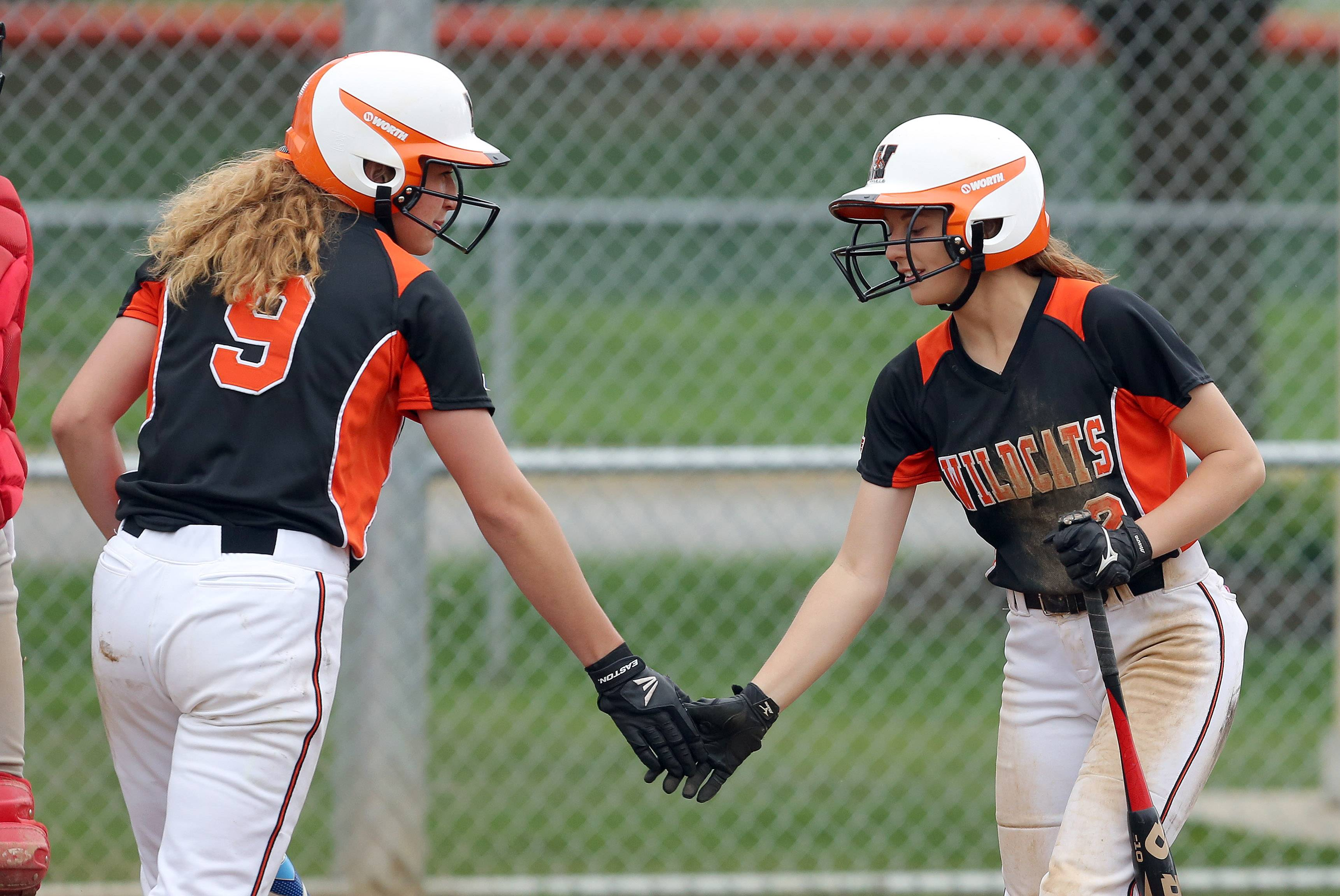 Libertyville's Michaela Mooney, left, and Jessie Lauret share a high-five after Mooney scored against visiting Mundelein on Tuesday.