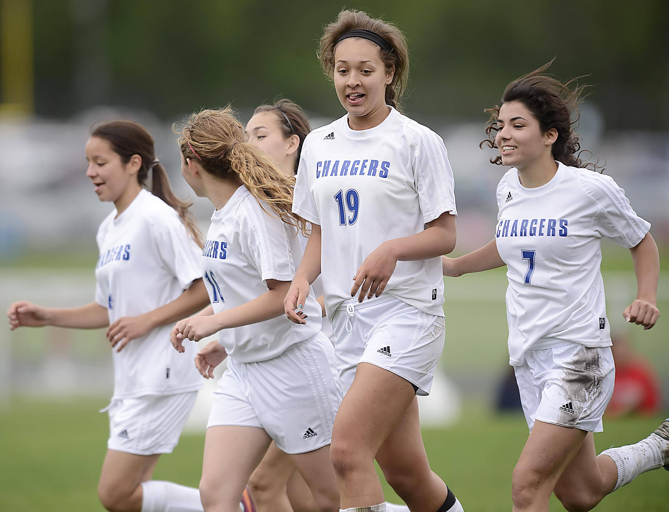 Dundee-Crown's Ashley Raby is surrounded by teammates after her second-half goal against Jacobs Tuesday in Carpentersville. It was the only score of the game.