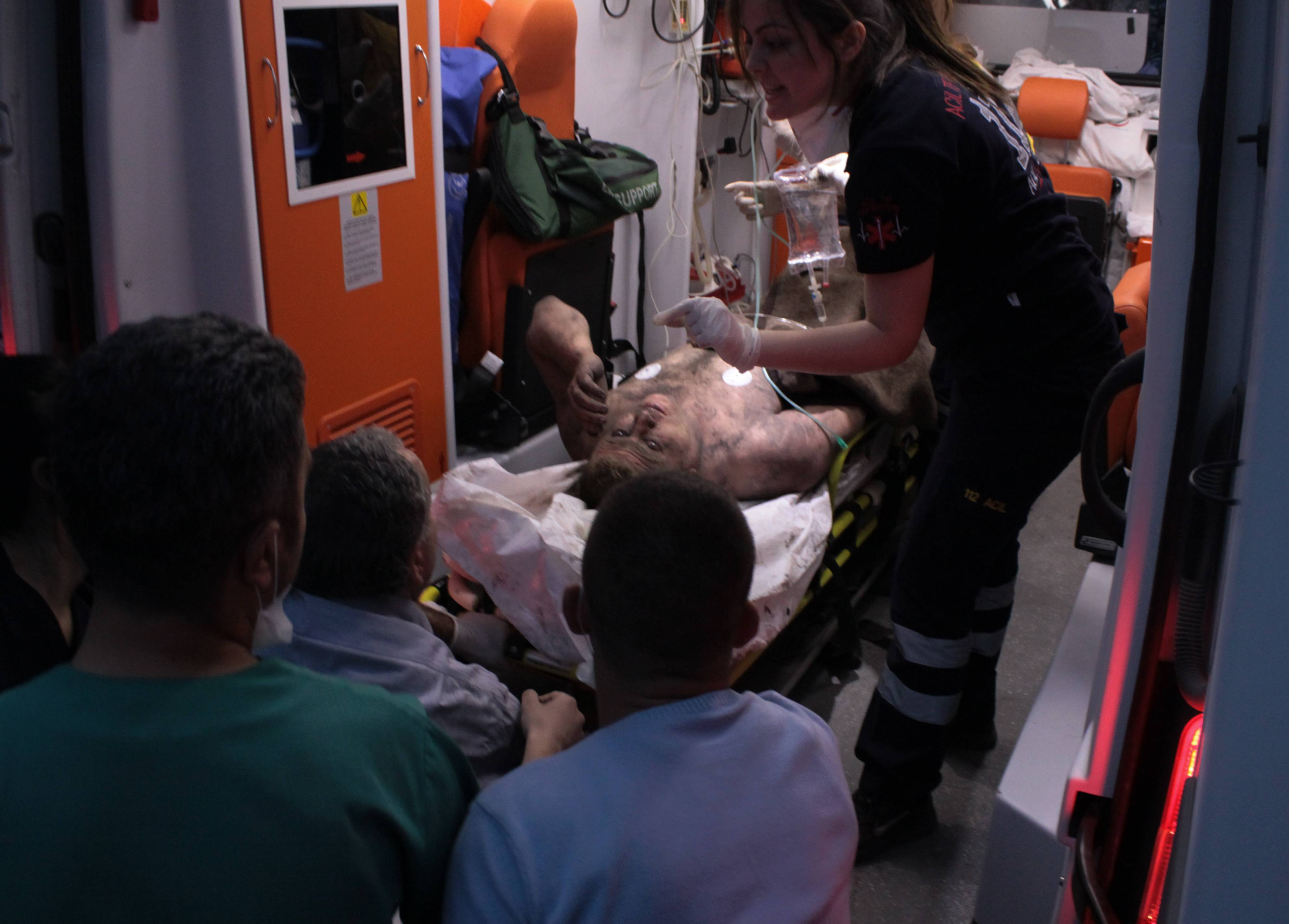 Medics place an injured miner into an ambulance after an explosion and fire at a coal mine in Soma, in western Turkey, Tuesday. An explosion and fire at the mine killed at least 166 workers.