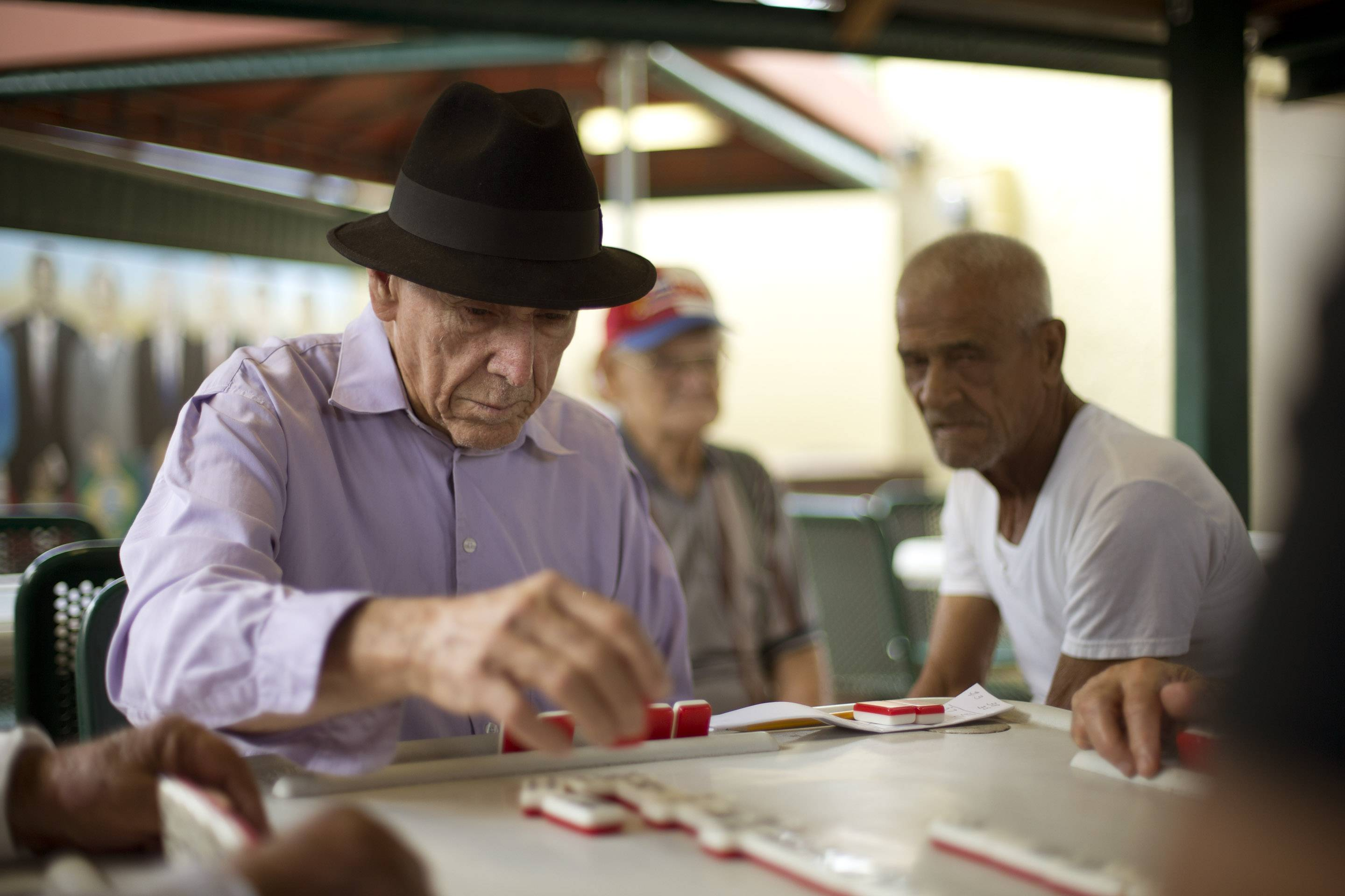 Men play dominoes on Calle Ocho (Eighth Street) in Miami's Little Havana.