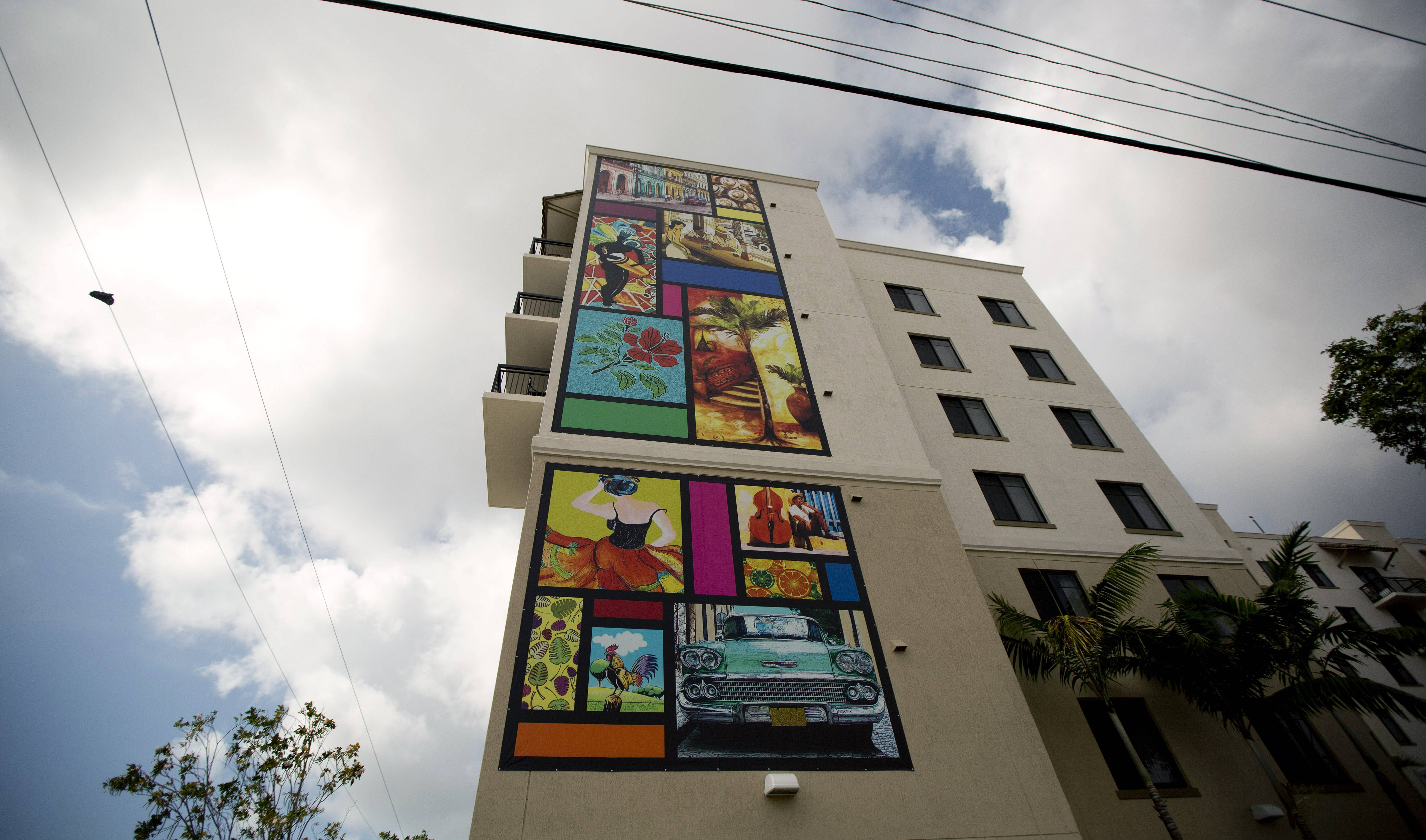A large mural decorates the side of an apartment building along Calle Ocho (Eighth Street) in Miami's Little Havana.