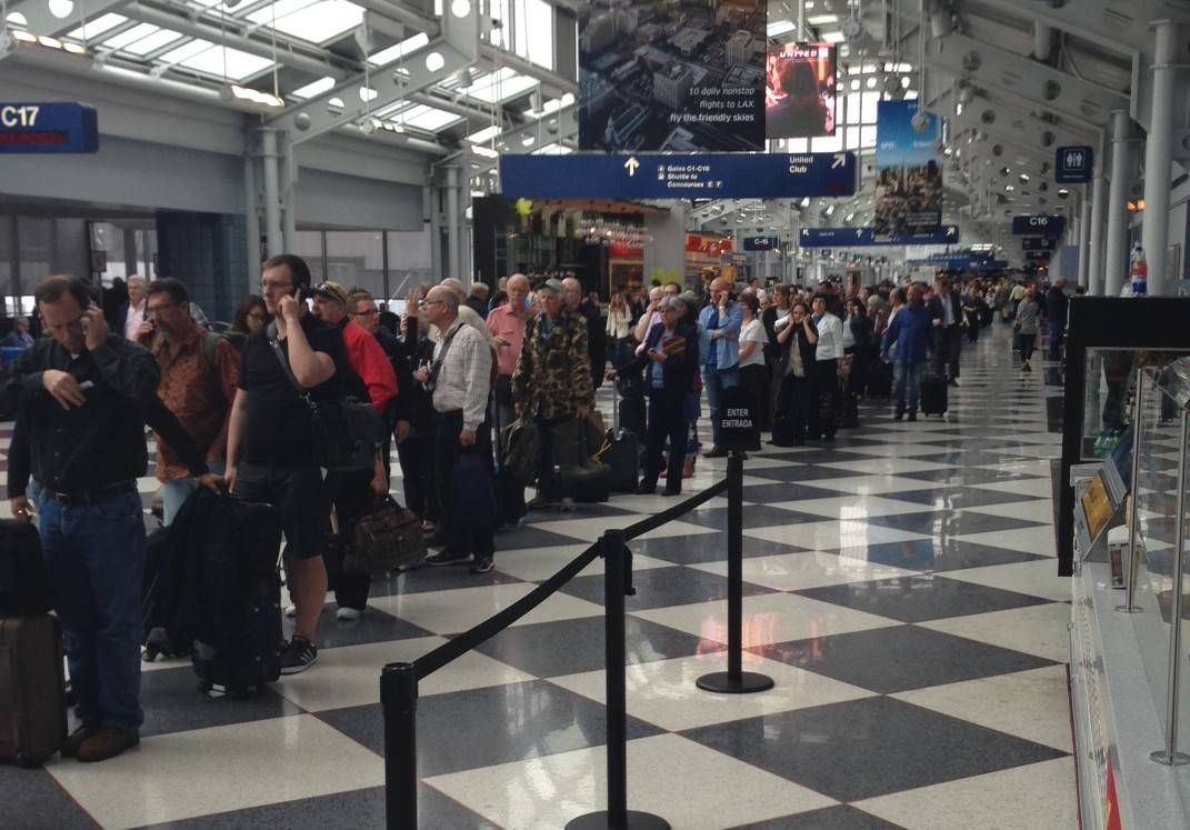 A long line of fliers wants to know what's going on at O'Hare after delays.