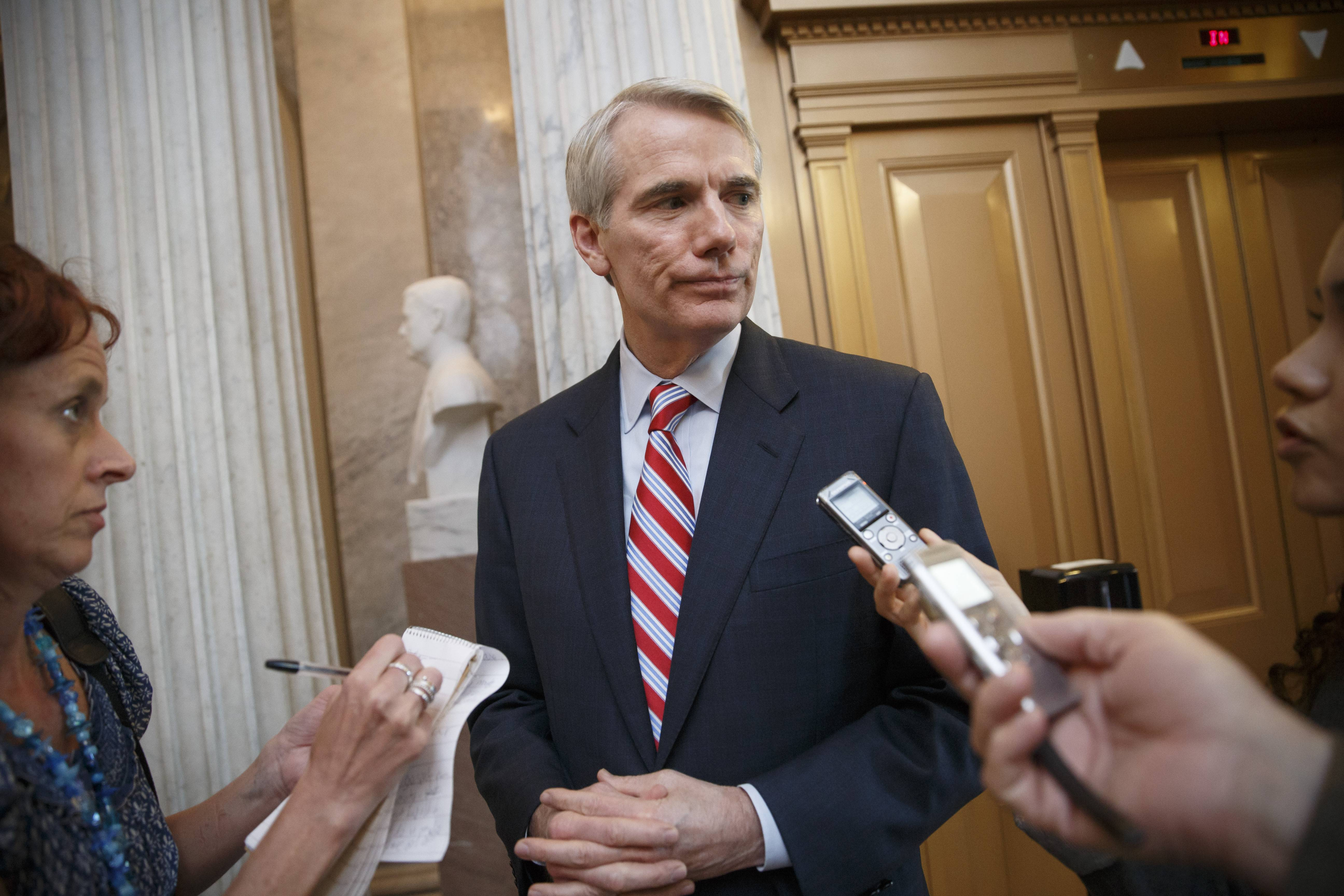 "Sen. Rob Portman, R-Ohio, center, one of the chief sponsors of the energy savings bill, said he would continue to work with Democrats and Republicans to try to find a way forward on the energy bill, part of a ""national, all-of-the-above energy strategy."""