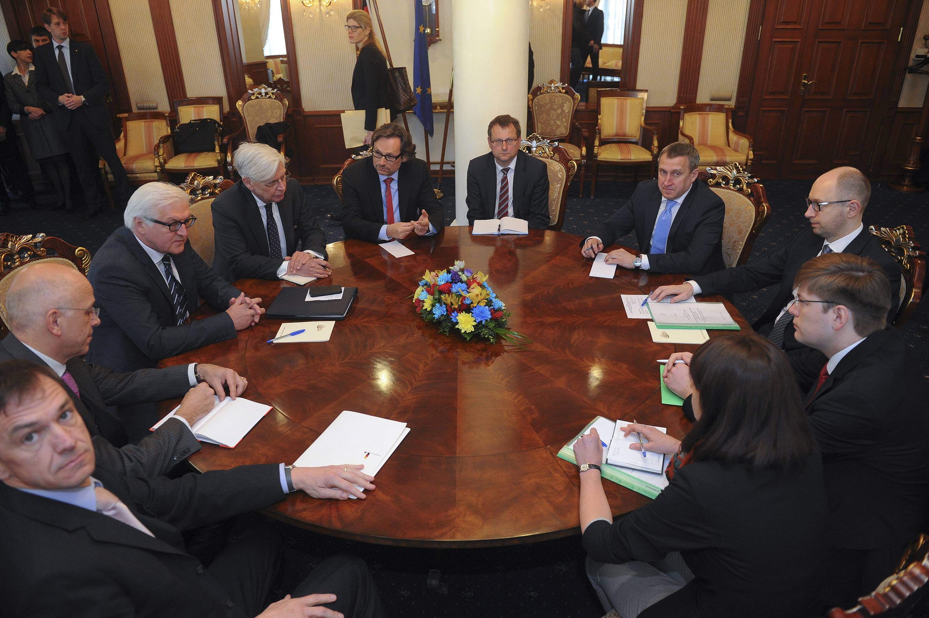 German Foreign Minister Frank-Walter Steinmeier, third from left, and Ukrainian Prime Minister Arseniy Yatsenyuk, right, attend a meeting in Kiev, Ukraine, Tuesday. Steinmeier flew to Ukraine Tuesday to help start talks between the Ukrainian government and its foes following the declaration of independence by two eastern region.