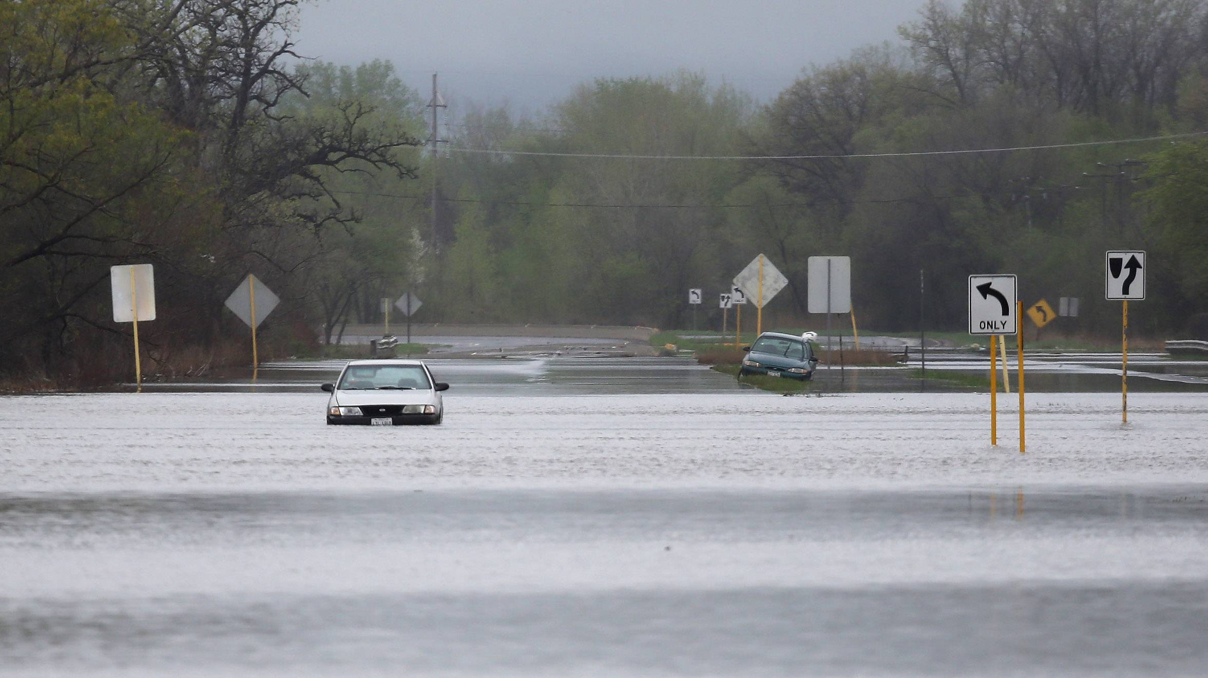 Cars were stranded in floodwaters on Route 41 south of Route 137 and the road was closed Tuesday morning due to flooding. Overnight storms caused area flooding and traffic problems in Lake County.