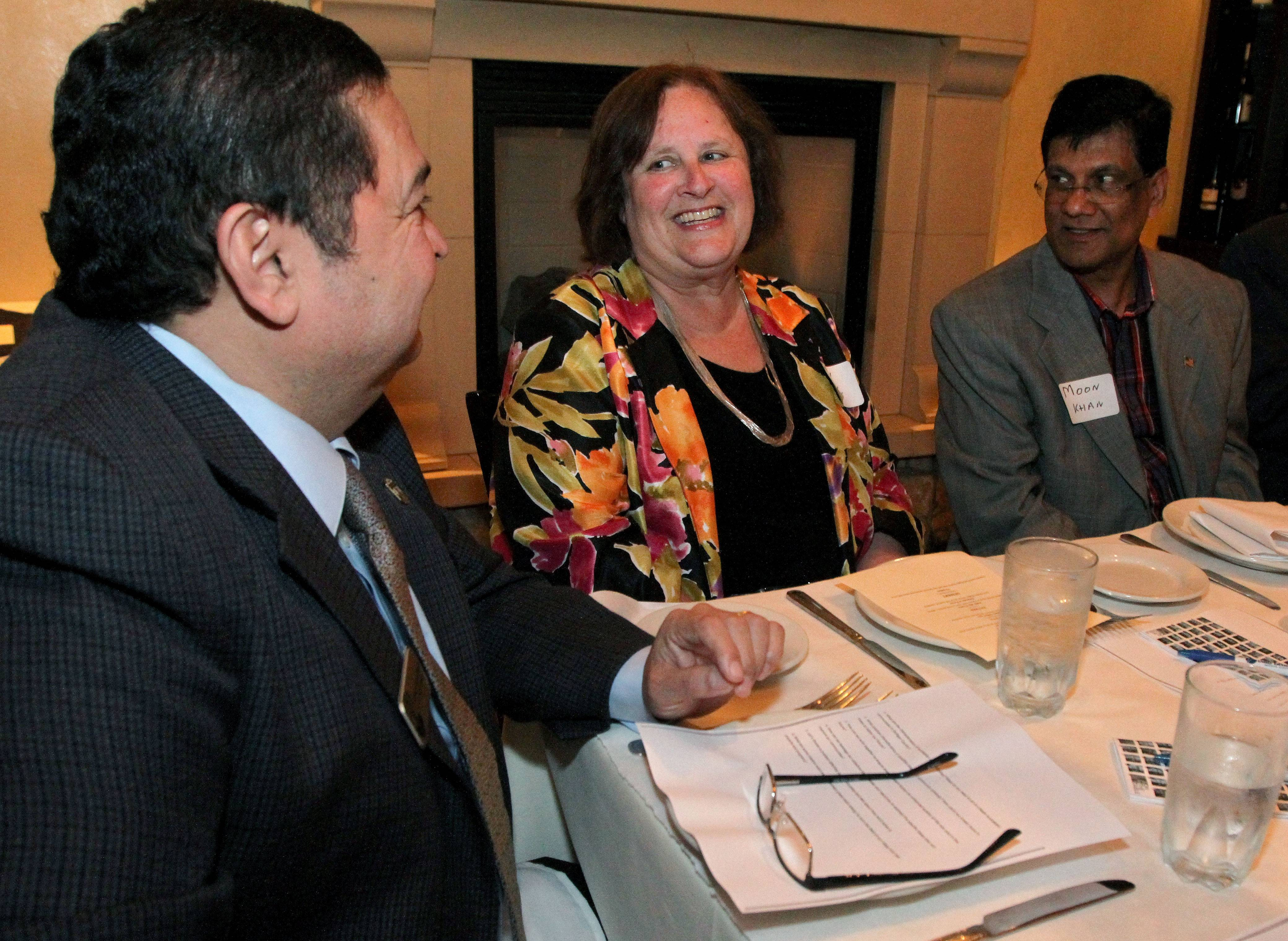 West Chicago Mayor Ruben Pineda, Naperville resident Peggy Frank and Lombard resident Moon Khan, president of Asian American Caucus of DuPage, discuss collaboration and ways to improve their communities Monday during an On the Table discussion hosted by Daily Herald Media Group Monday in Downers Grove/