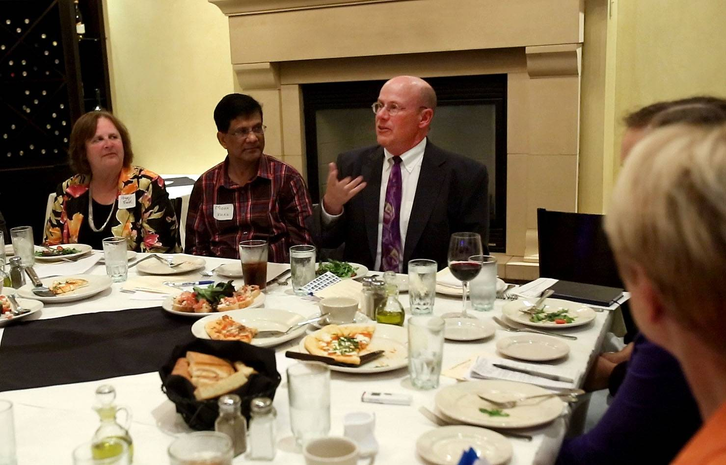 Bob Smith, Daily Herald DuPage County editor, leads an On the Table discussion in Downers Grove in which nine DuPage leaders discussed ways to build collaboration, trust, opportunities ad support for young people.