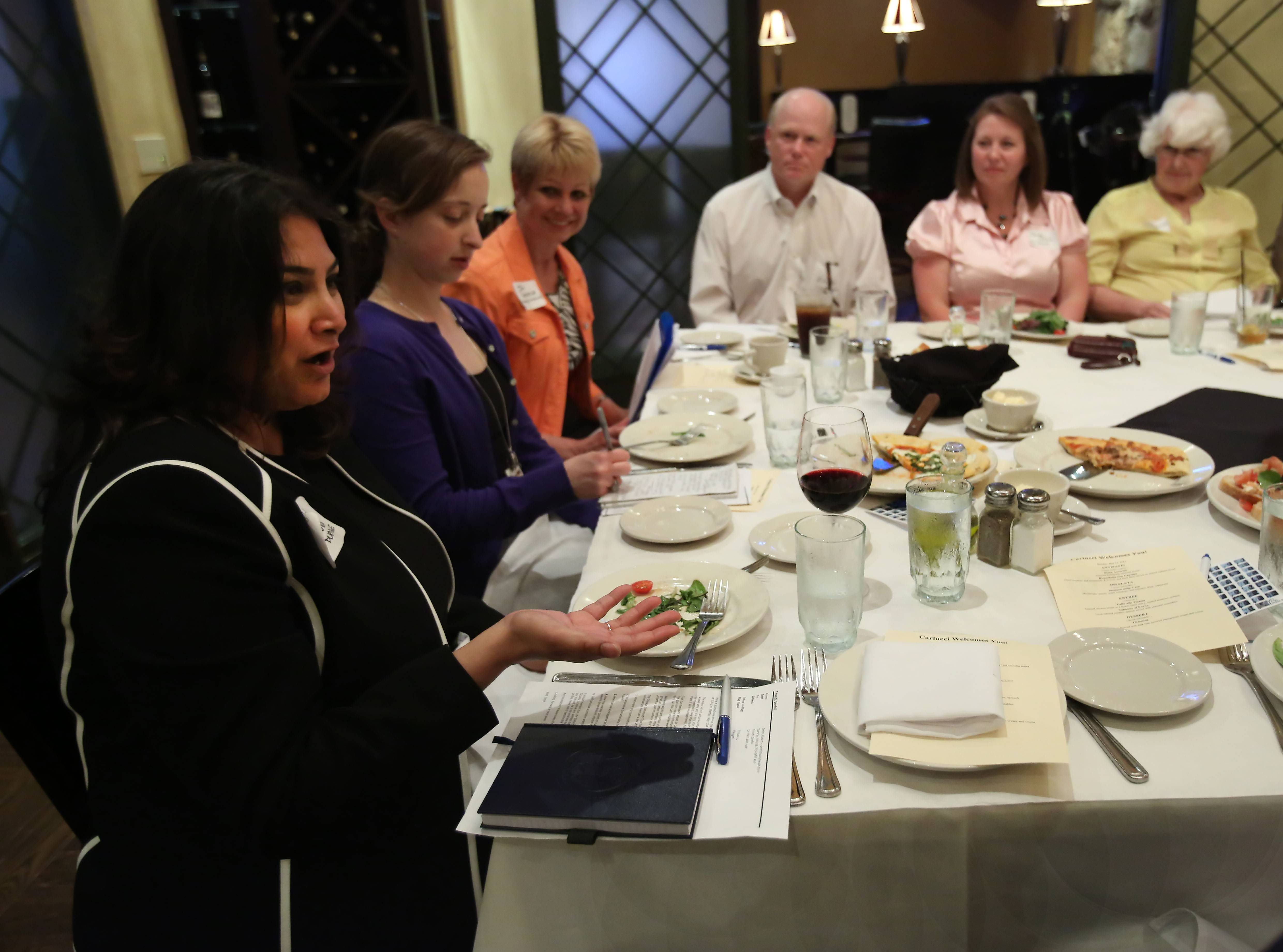 Shefali Trivedi, executive director of Giving DuPage, describes how her organization can serve to connect other volunteer and charitable efforts in the county during an On the Table discussion Monday in Downers Grove.