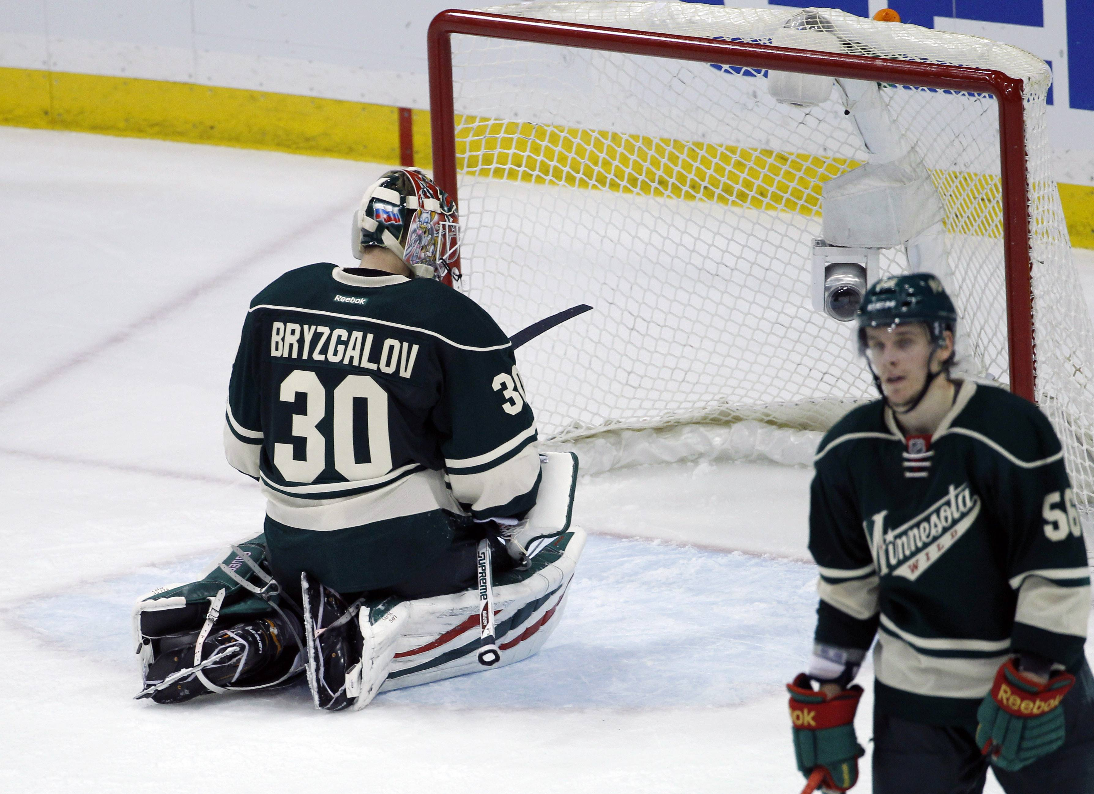 Minnesota Wild goalie Ilya Bryzgalov (30), of Russia, kneels in front of the net after Chicago Blackhawks right wing Patrick Kane scored the game-winning goal on him during overtime.