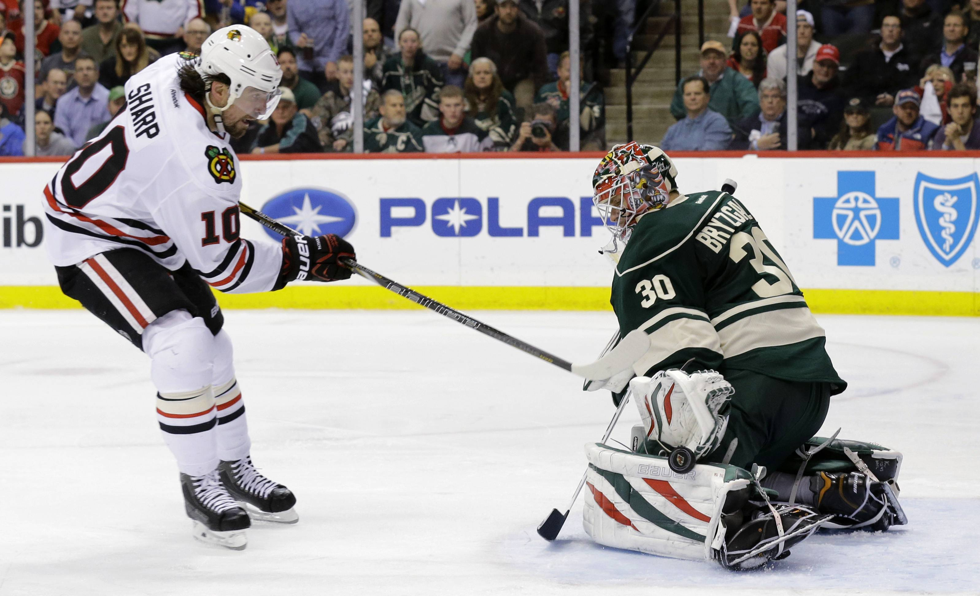 Minnesota Wild goalie Ilya Bryzgalov (30), of Russia, deflects a point-blank shot by Chicago Blackhawks left wing Patrick Sharp (10) during the second period.