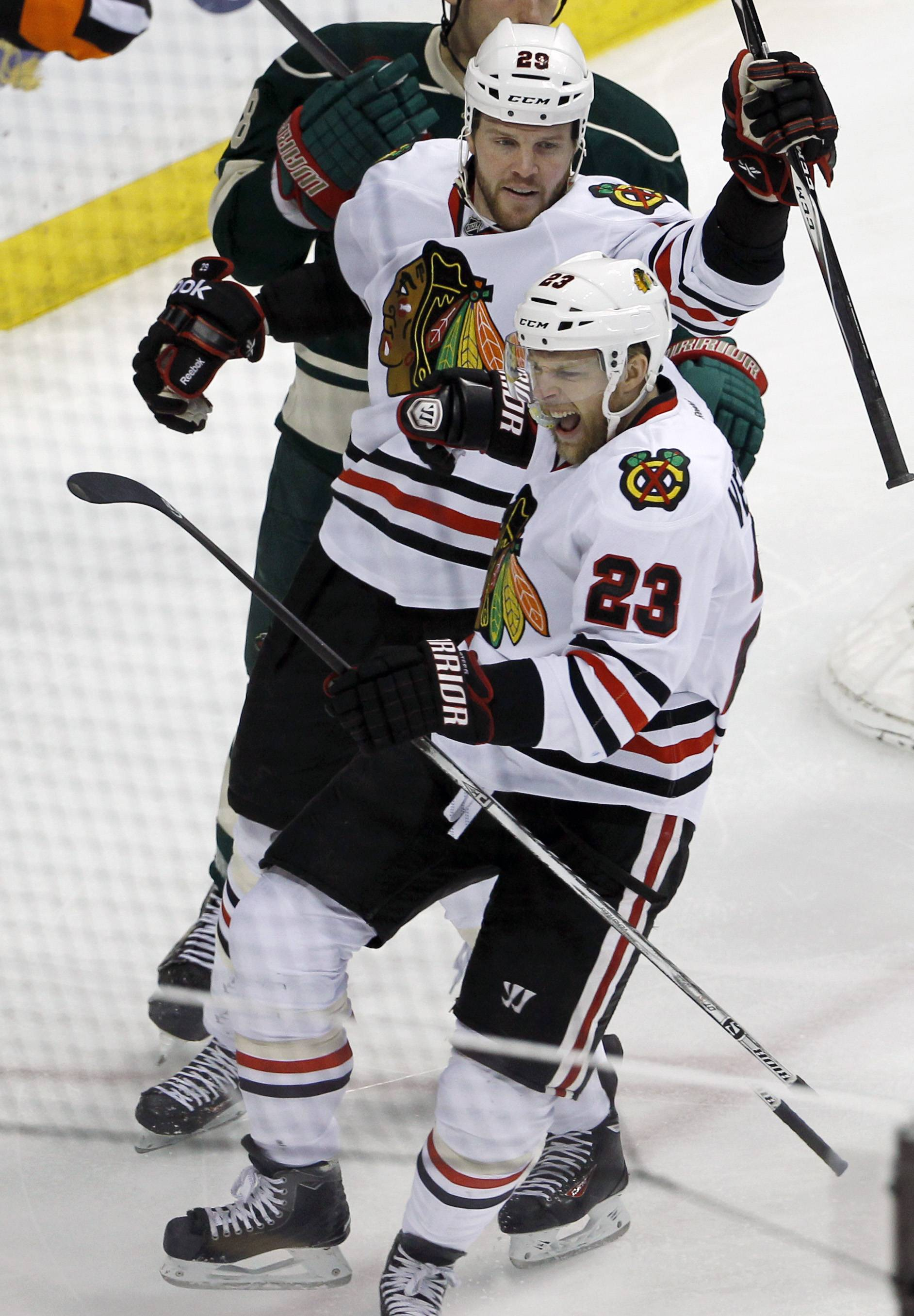 Chicago Blackhawks right wing Kris Versteeg (23) reacts in front of Blackhawks left wing Brandon Saad (20) after scoring on Minnesota Wild goalie Ilya Bryzgalov during the first period of Game 6 of an NHL hockey second-round playoff series in St. Paul, Minn., Tuesday, May 13, 2014.