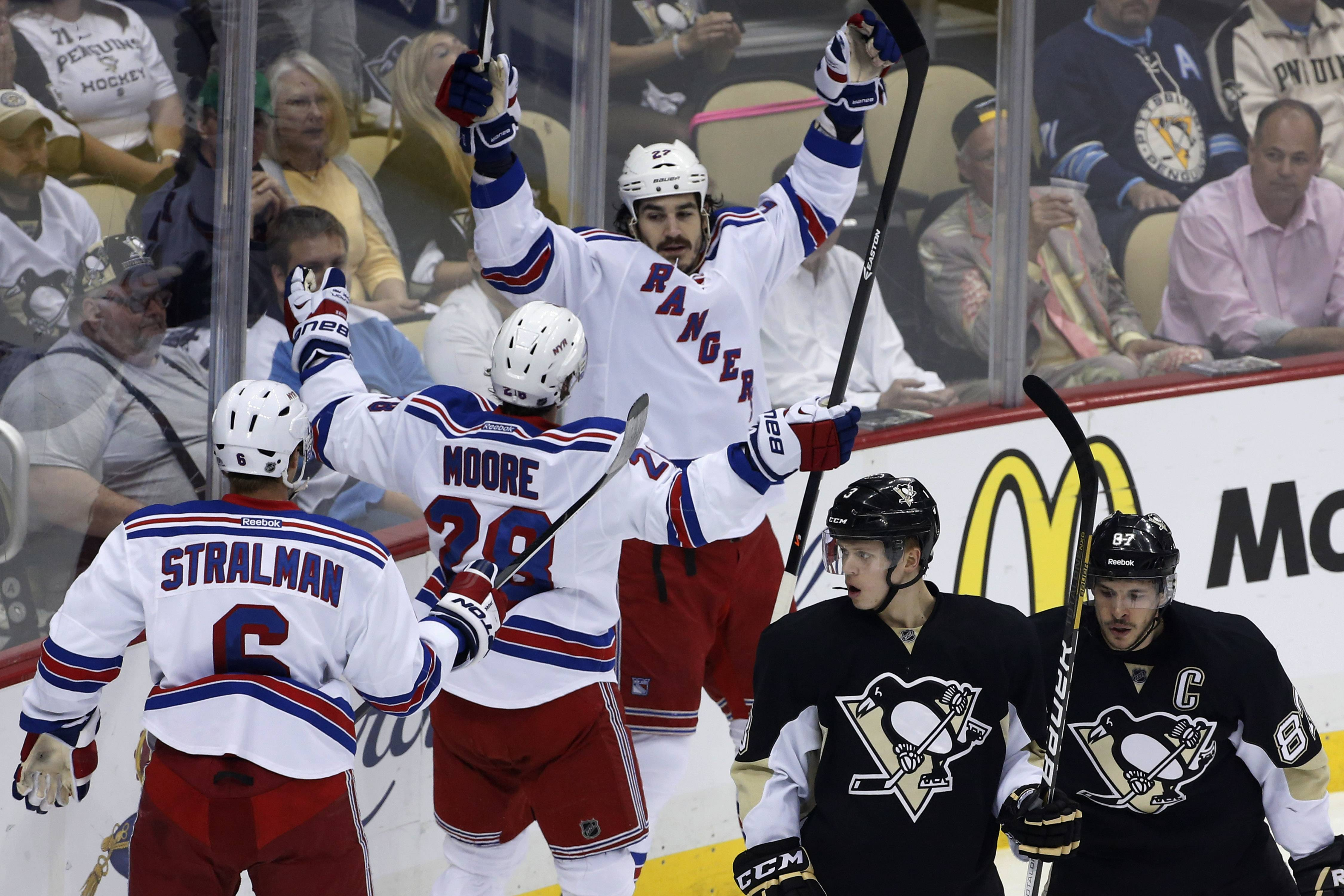New York Rangers' Brian Boyle (22) celebrates his goal with teammates Anton Stralman (6) and Dominic Moore as Pittsburgh Penguins' Sidney Crosby (87) and Olli Maatta (3) skate back to their bench in the first period of Game 7 of a second-round NHL playoff hockey series, in Pittsburgh on Tuesday, May 13, 2014.