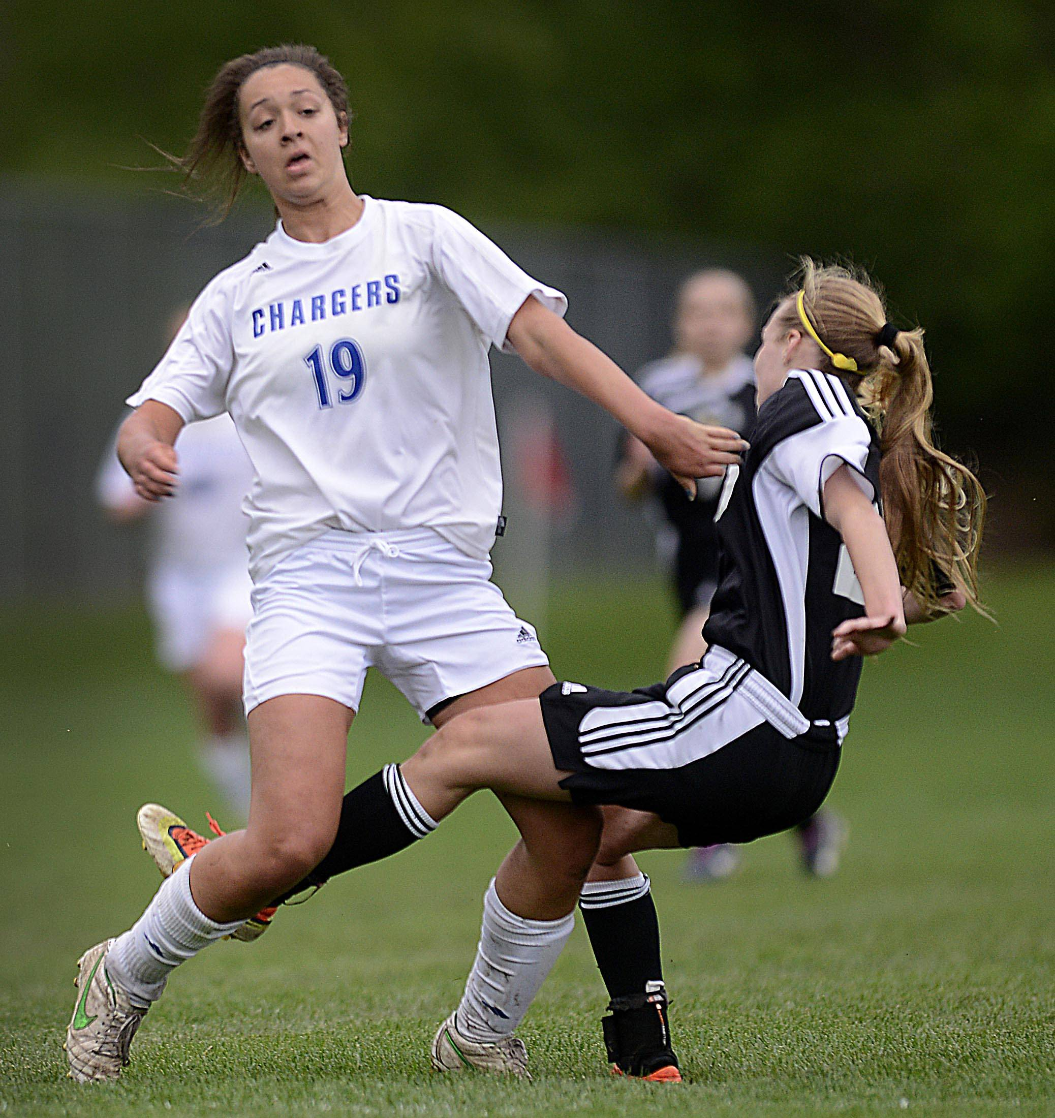 Dundee-Crown's Ashley Raby collides with Jacobs' Heather Hoffmann Tuesday in Carpentersville.