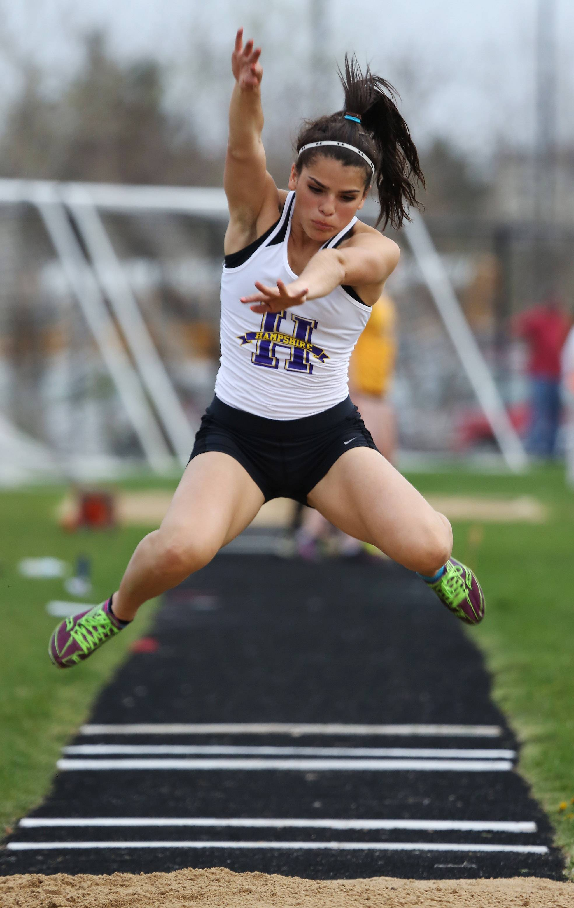 Elizabeth Pagan of Hampshire competes in the long jump during the Fox Valley Conference girls varsity track meet Thursday at Grayslake North High School.