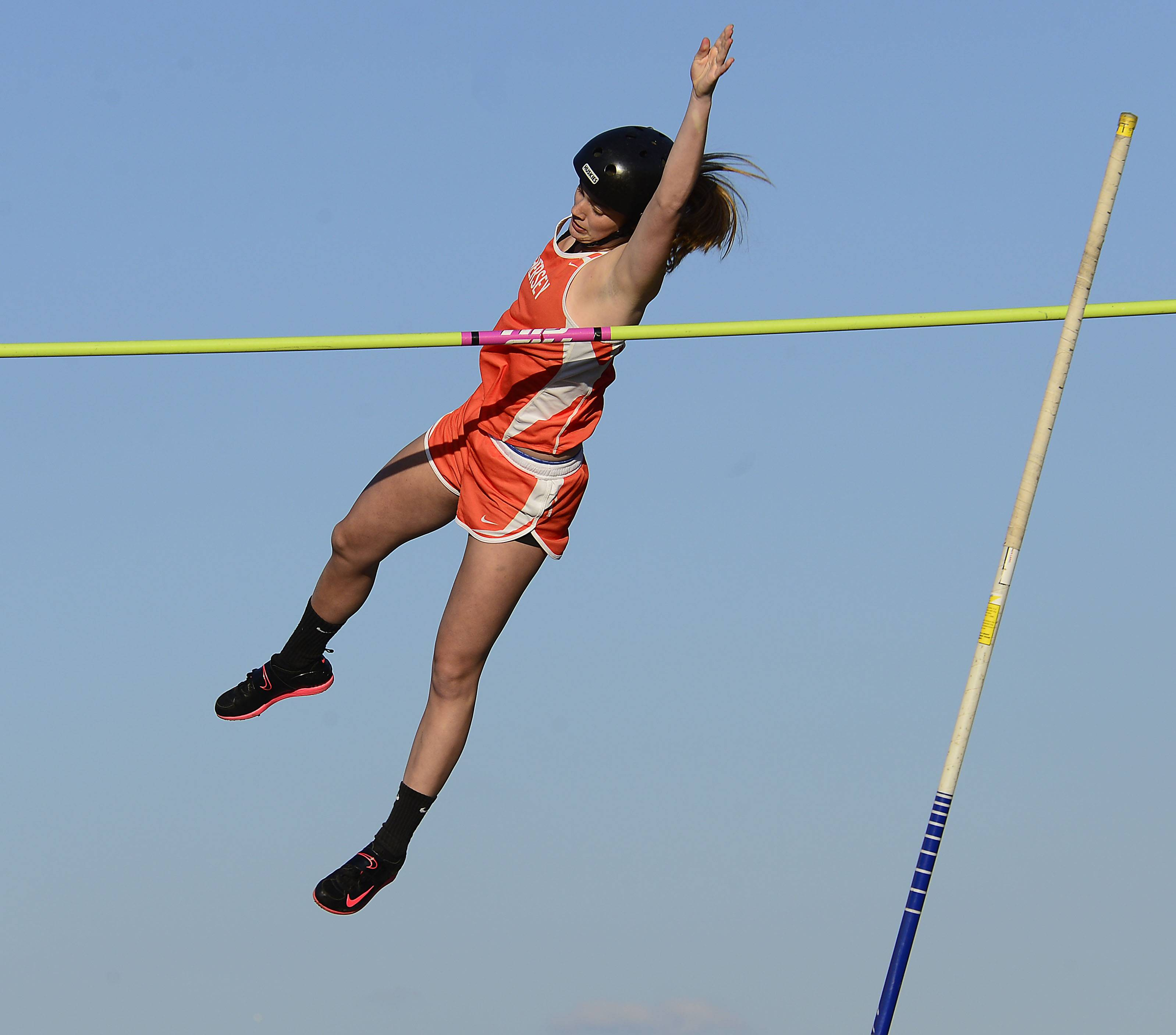 Hersey's Kelly Hill clears 10.6 in the pole vault at the MSL Girls Championships at Wheeling on Friday.