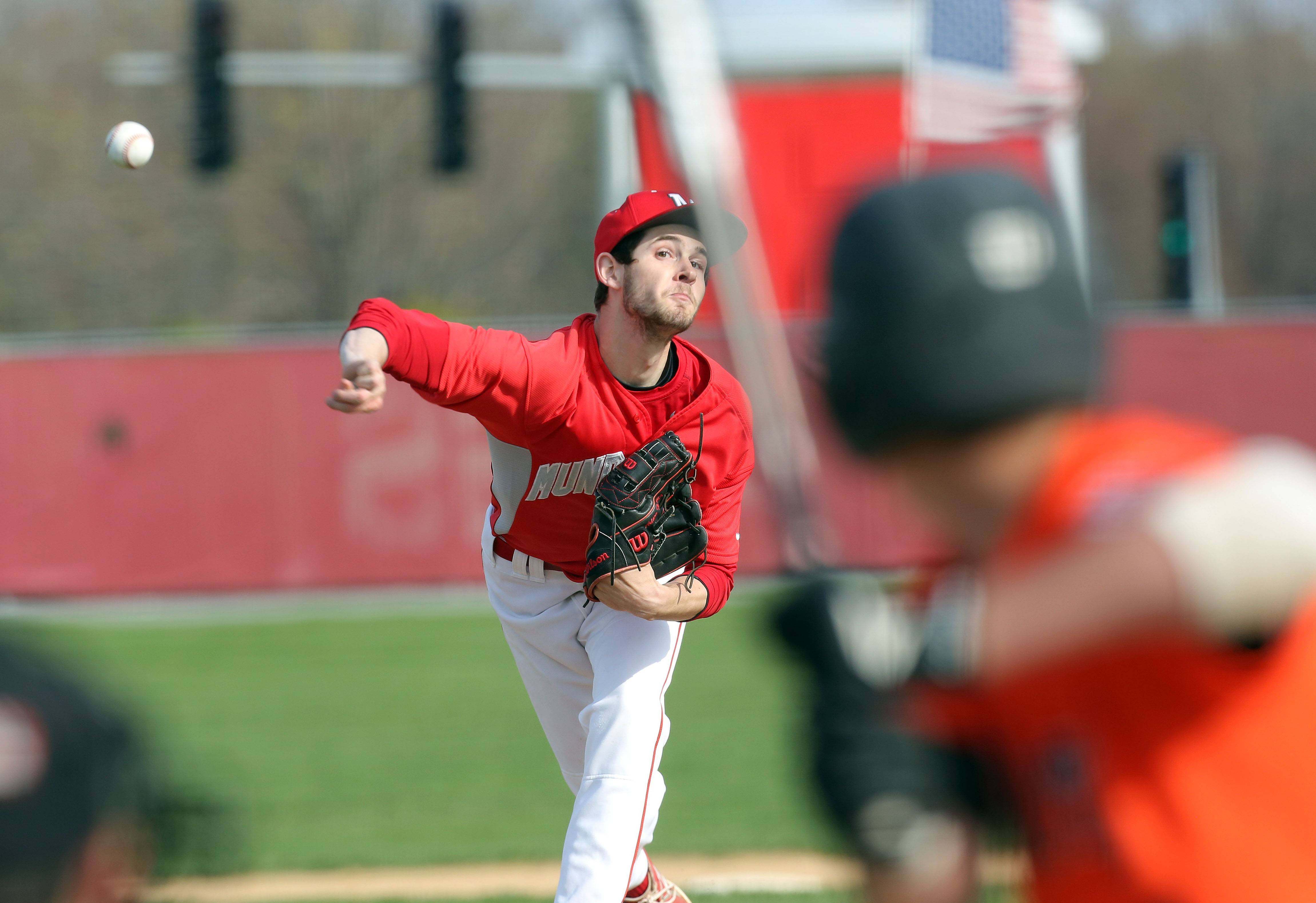 Mundelein's Adam Turner pitches during their game against Libertyville Tuesday at Mundelein High School.