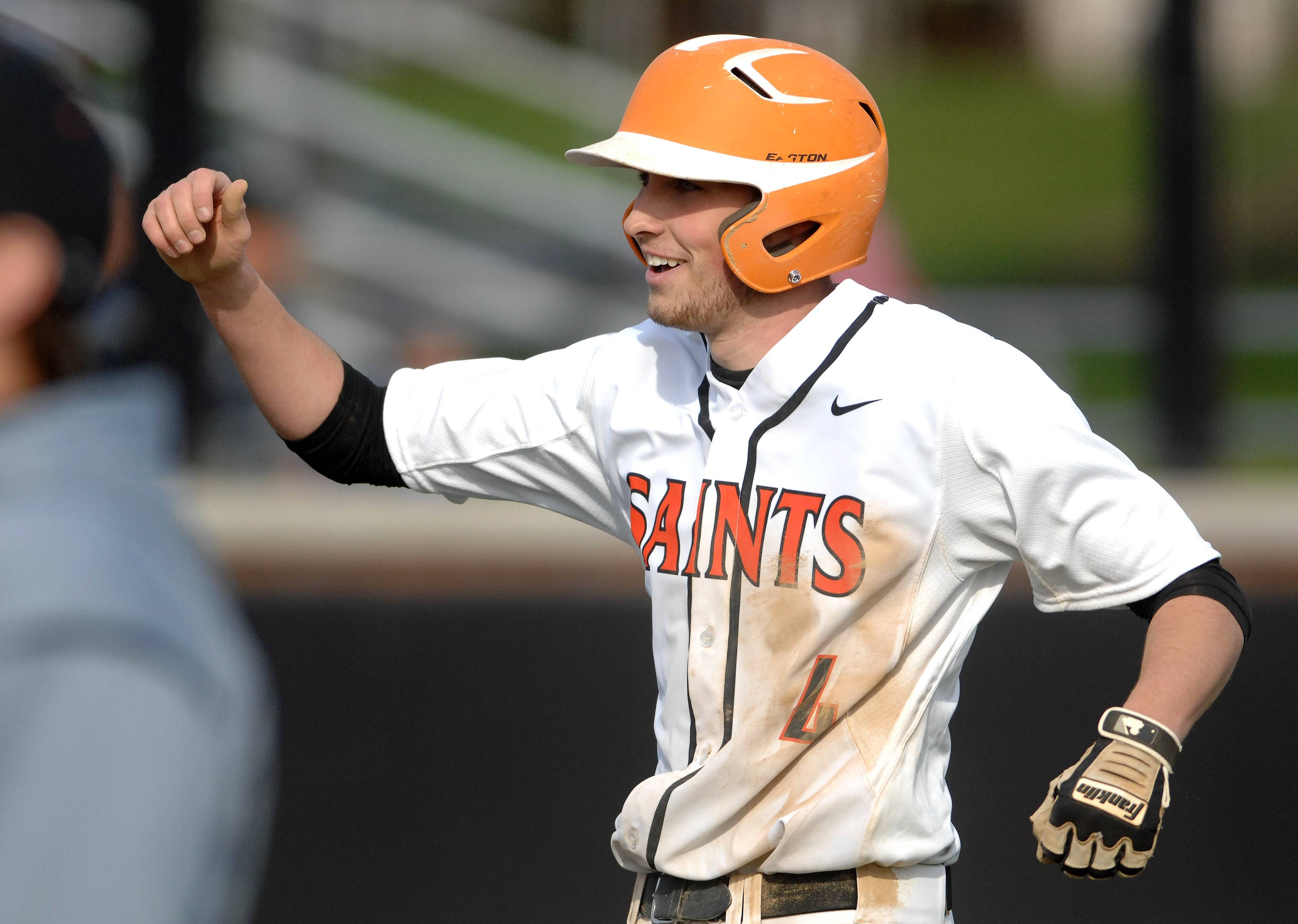 St. Charles East's Charles Alex Abate (4) is congratulated as he returns to the dugout after an RBI double during Tuesday's game at St. Charles East. He was thrown out trying to stretch it into a triple.
