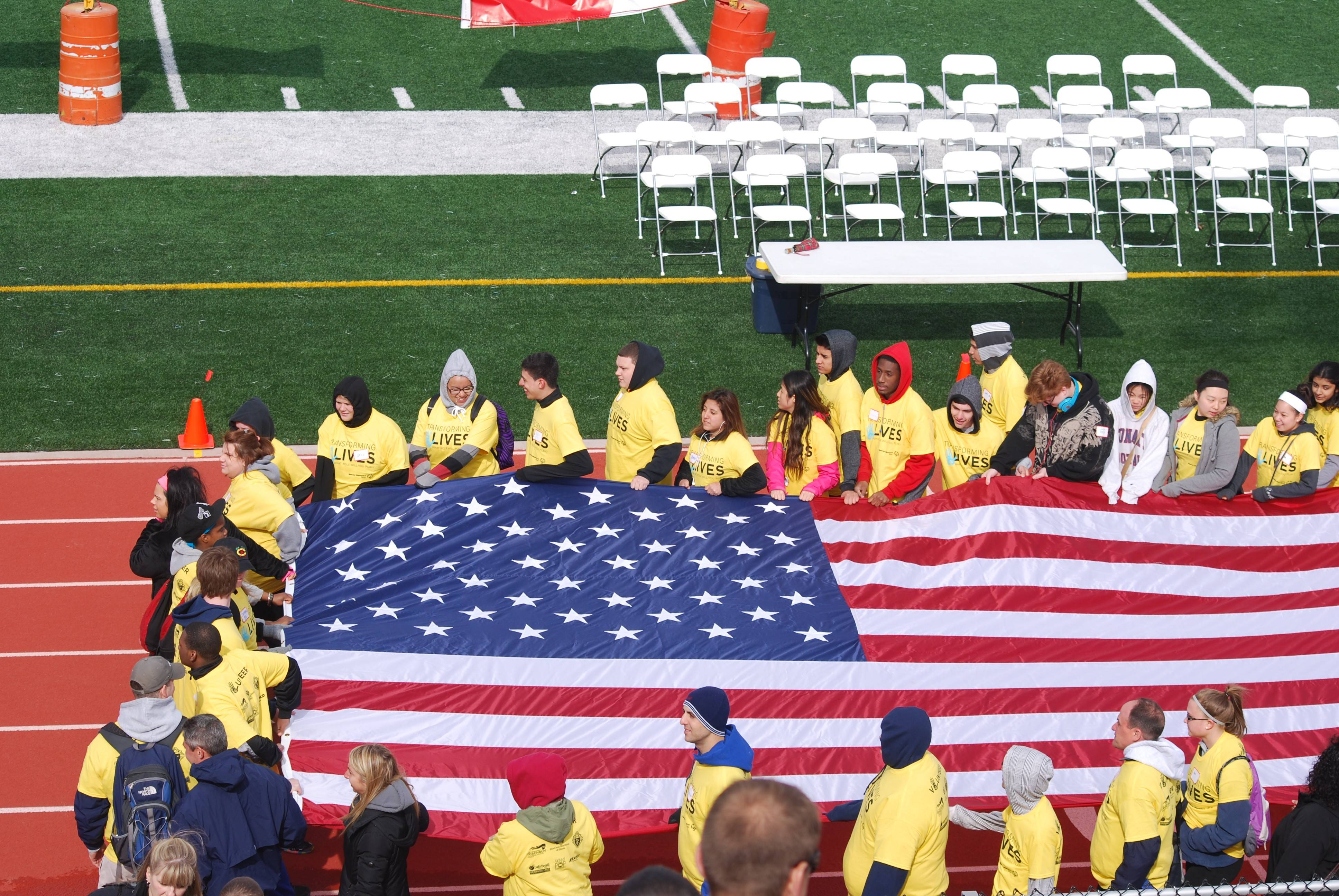 Conant students carry the flag in the March of Athletes during the opening ceremonies of the Area 18 Northwest Special Olympics Summer Games.