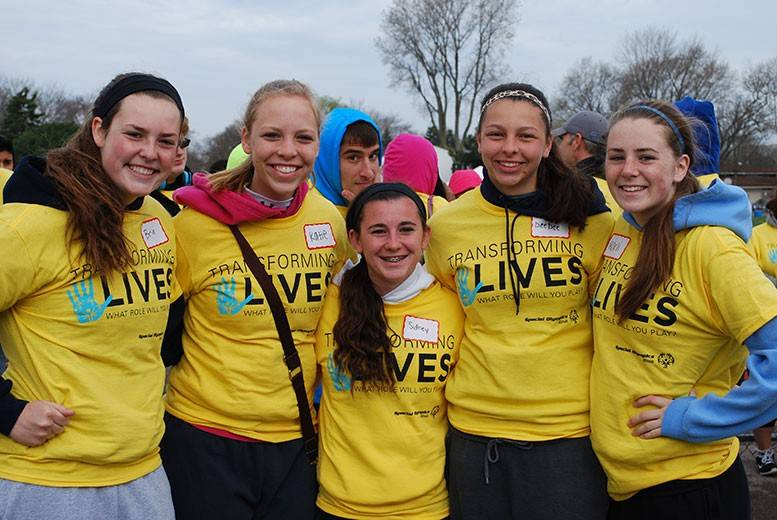 Volunteers from the girls soccer team at the Area 18 Northwest Special Olympics Summer Games at Prospect High School.