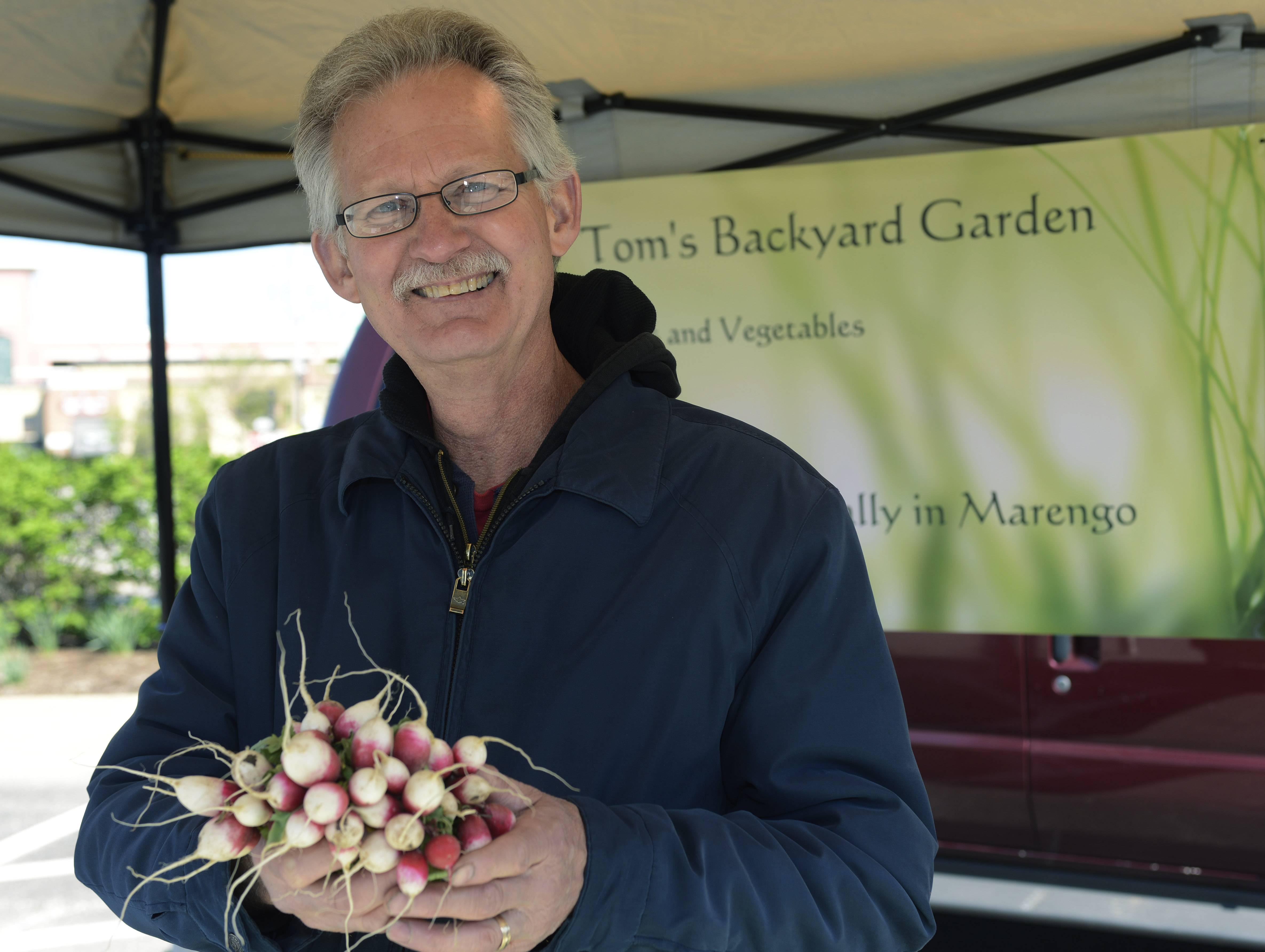 Tom Anderson of Tom's Backyard Garden sells produce at the Palatine Farmers Market.