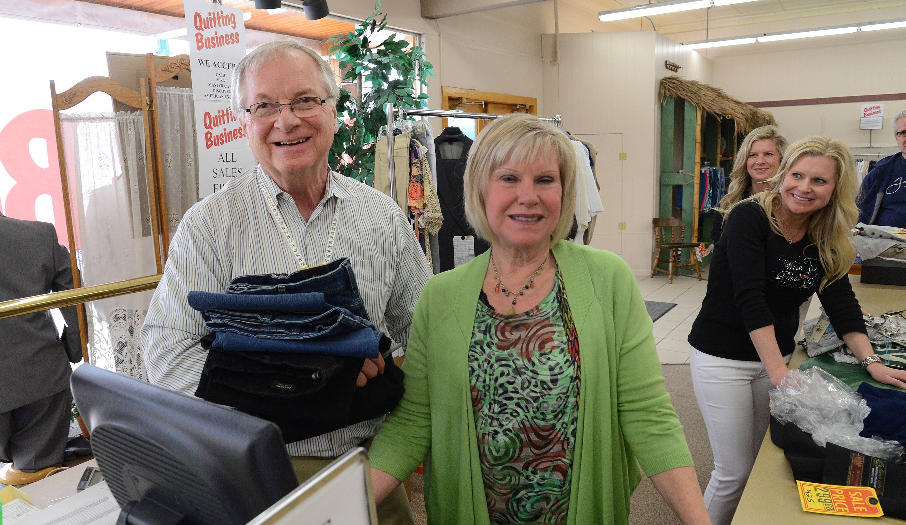 Four Squires clothing store owners, Lance and Sue Hansen, are retiring and closing the store that has operated in downtown Antioch since 1972. Their daughters, Heather Knies and Melissa Kann, are helping in the background.