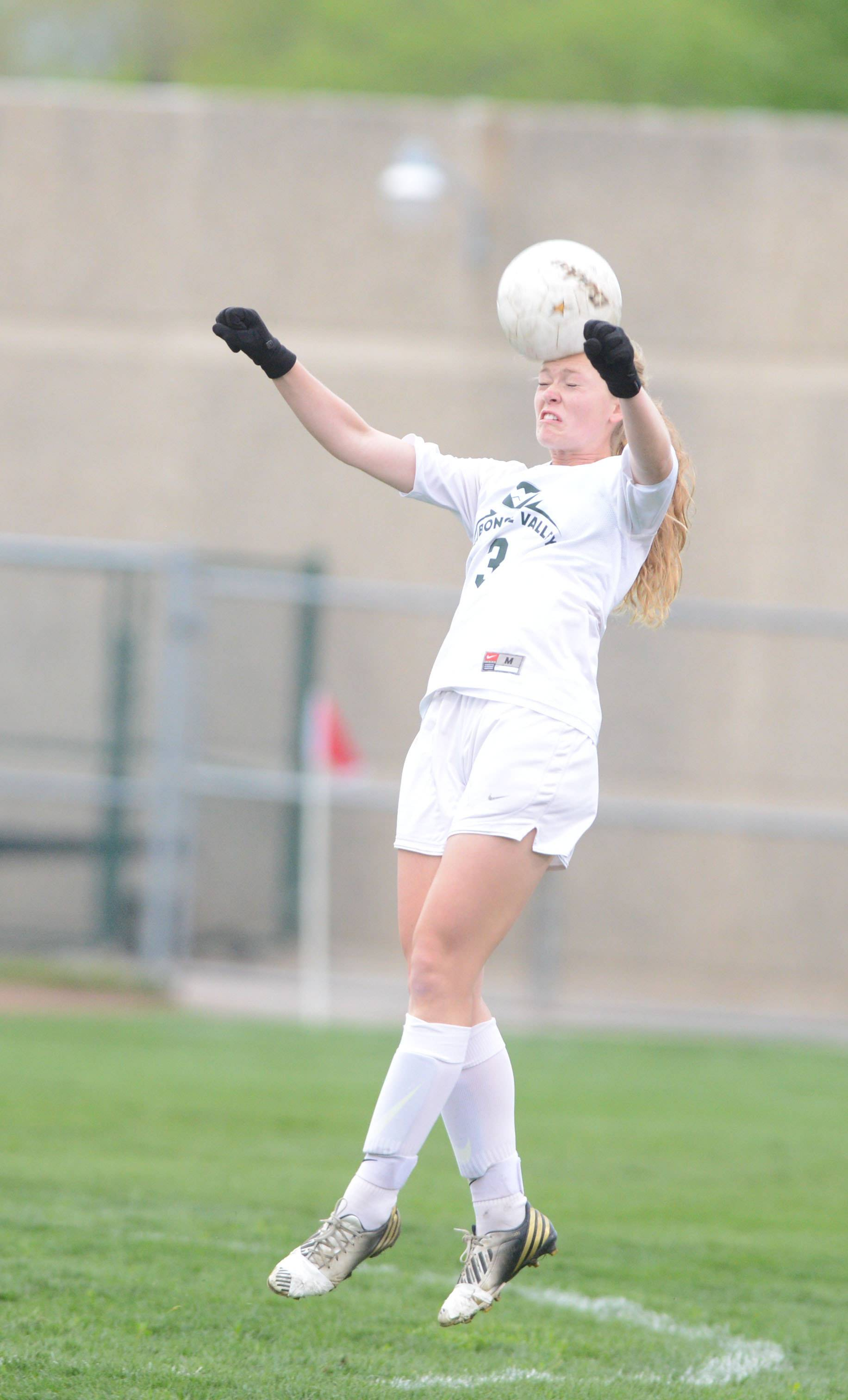 Morgan Kemerling of Waubonsie goes up for ahead shot during the St. Charles North at Waubonsie Valley girls soccer game Wednesday.