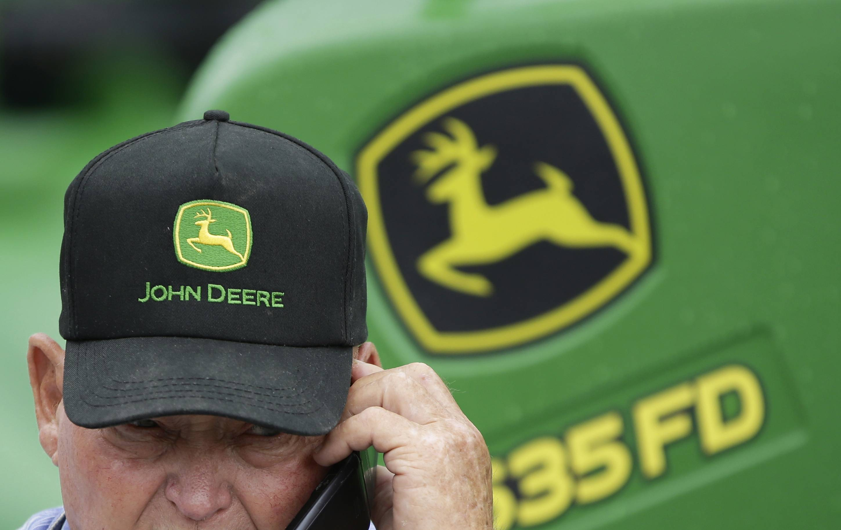 Deere is reporting a 9.5 percent decline in second-quarter net income on lower demand for farming equipment.