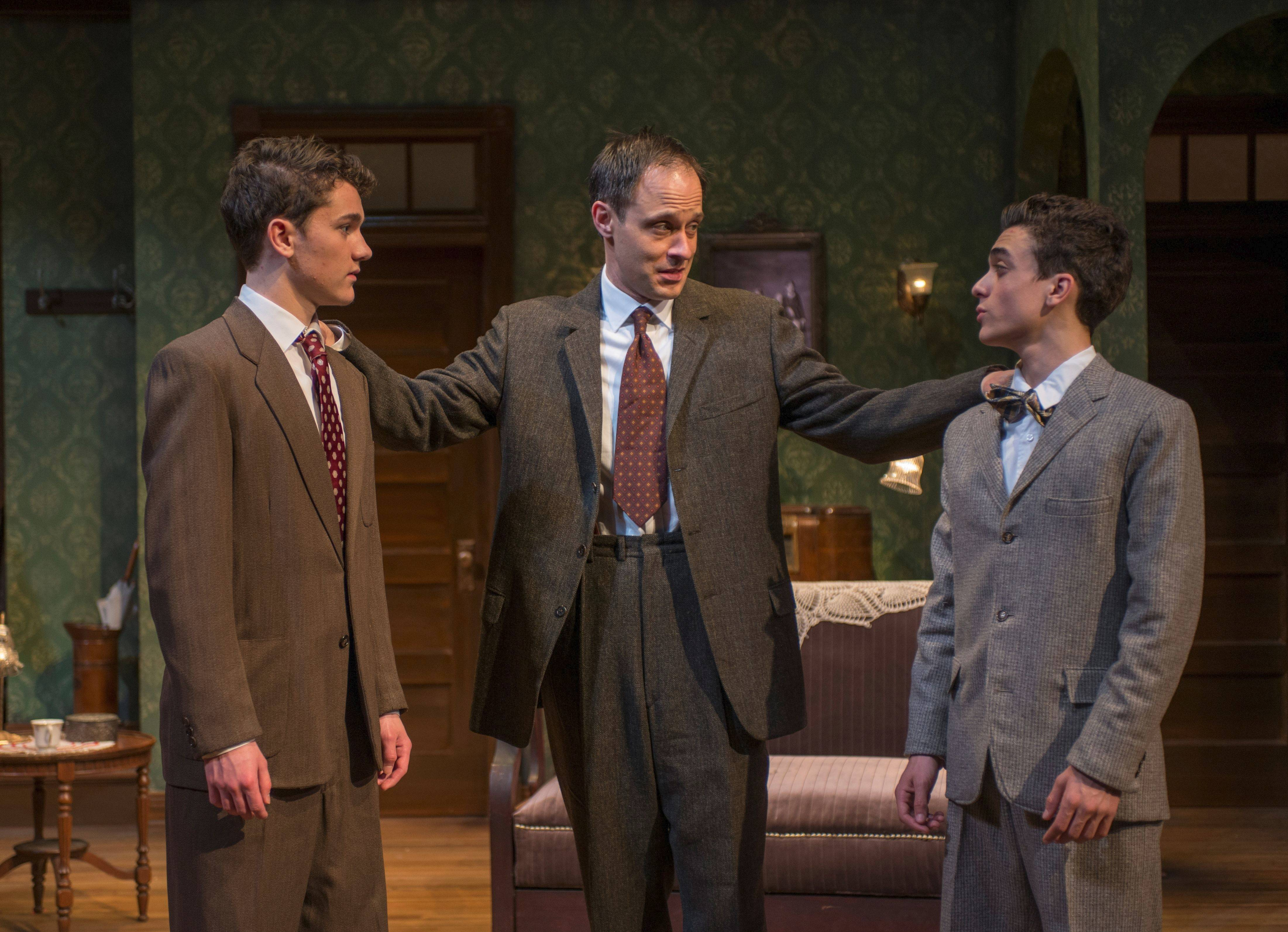 "Eddie (Timothy Edward Kane), center, explains to his teenage sons Jay (Alistair Sewell), left, and Arty (Sebastian W. Weigman) why they must stay with their Iron Lady grandmother in Neil Simon's ""Lost in Yonkers,"" running through June 8 at Northlight Theatre."