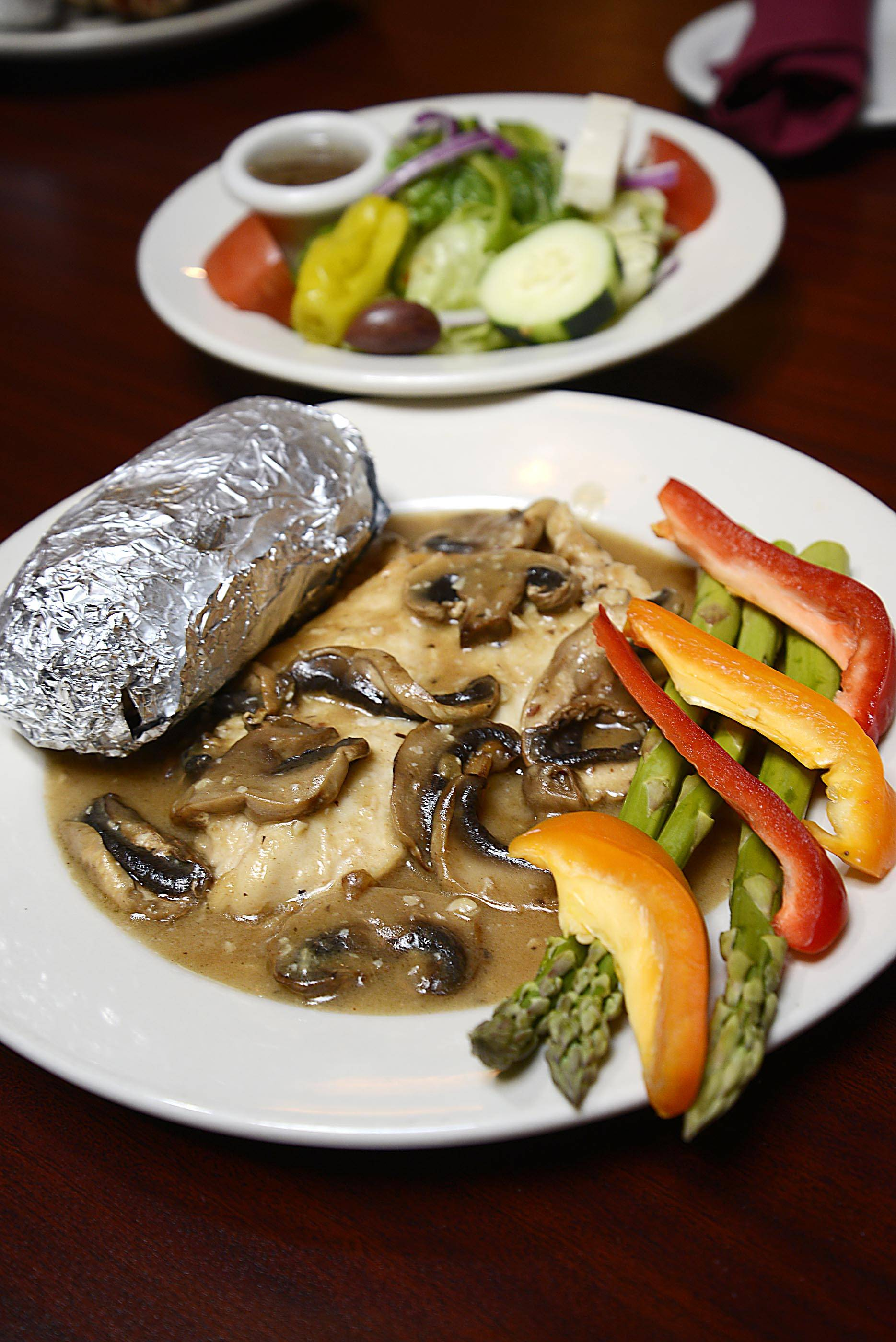Chicken Breast Picante, sautéed with white wine and mushrooms, comes with a Greek salad at North Avenue Charhouse in St. Charles.