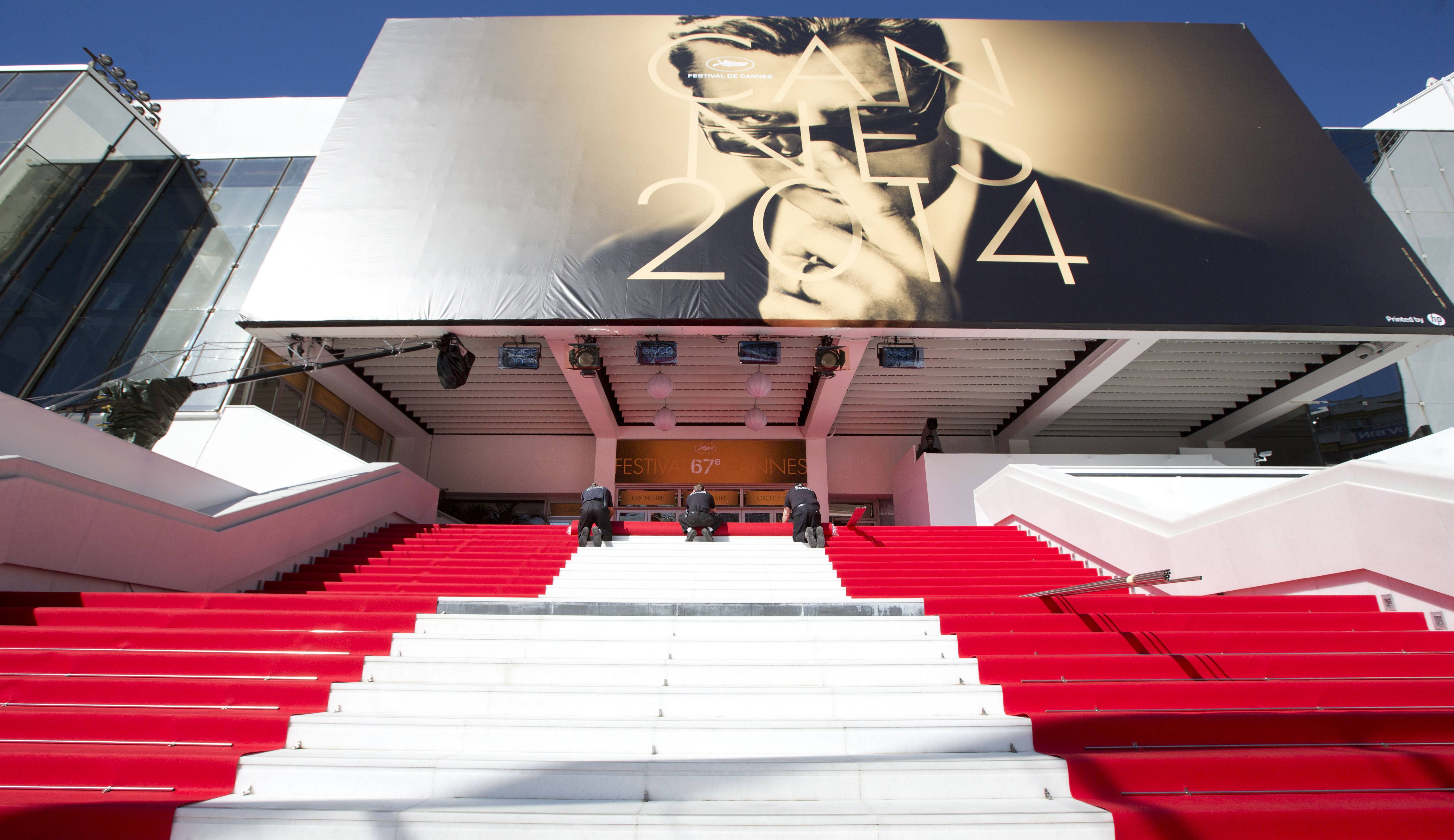 Workers prepare the red carpet Wednesday on the stairs of the Palais des Festivals before the start of the 67th Cannes Film Festival in southern France.  The festival runs until May 25.